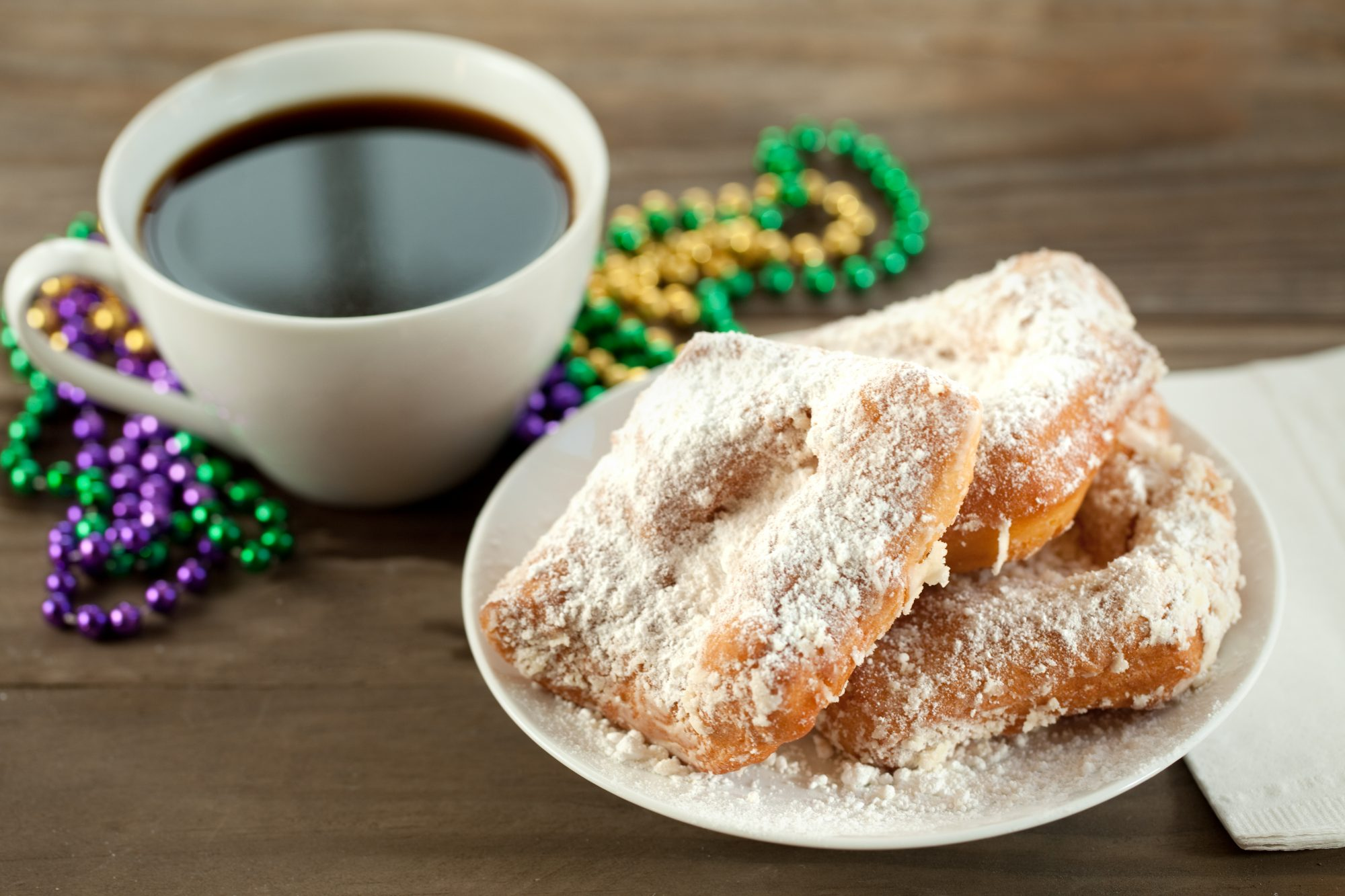 Beignet with coffee and beads Getty 7/7/20