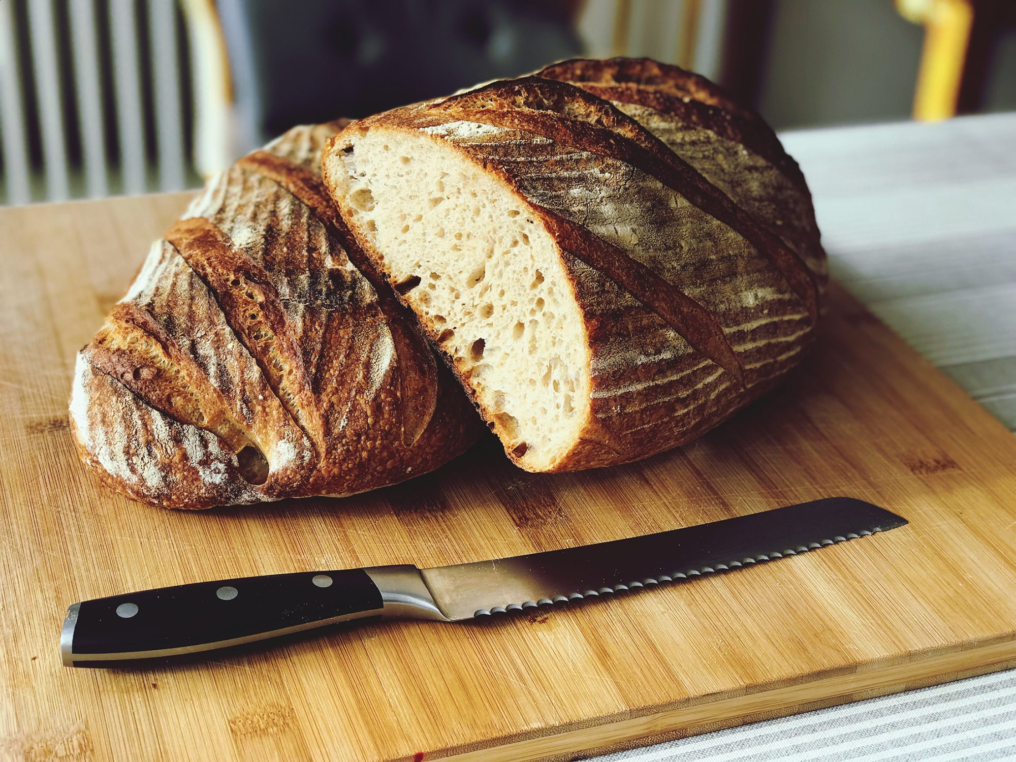 bread-on-cutting-board-1183163054.jpg