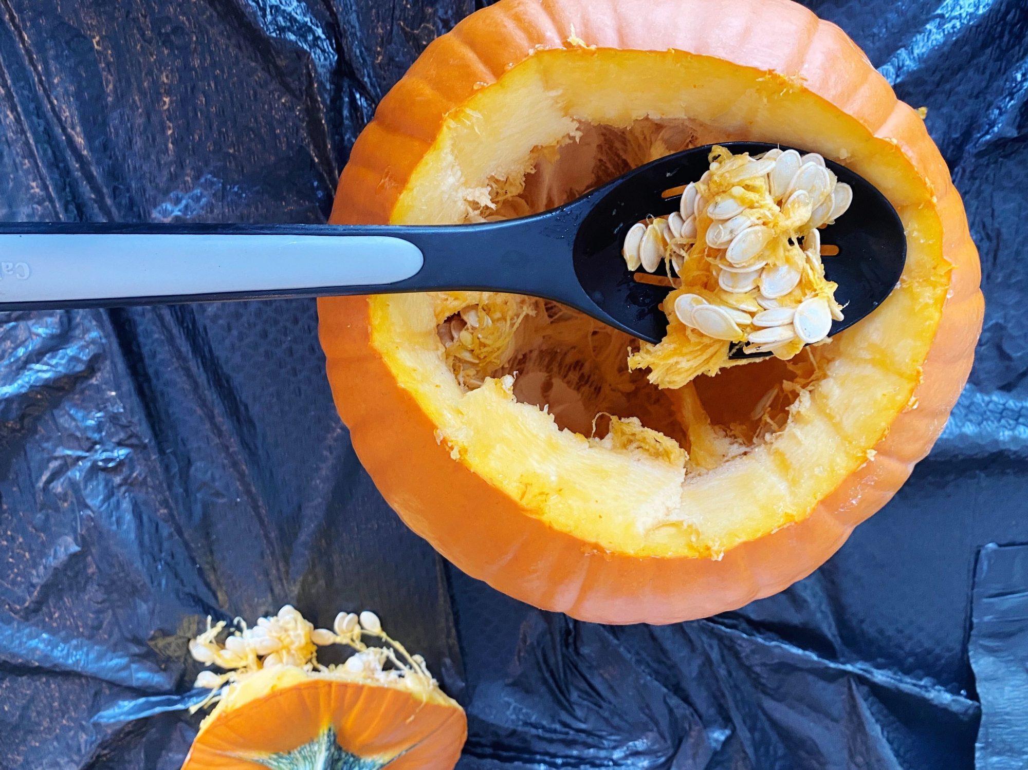 Scooping pumpkin seeds