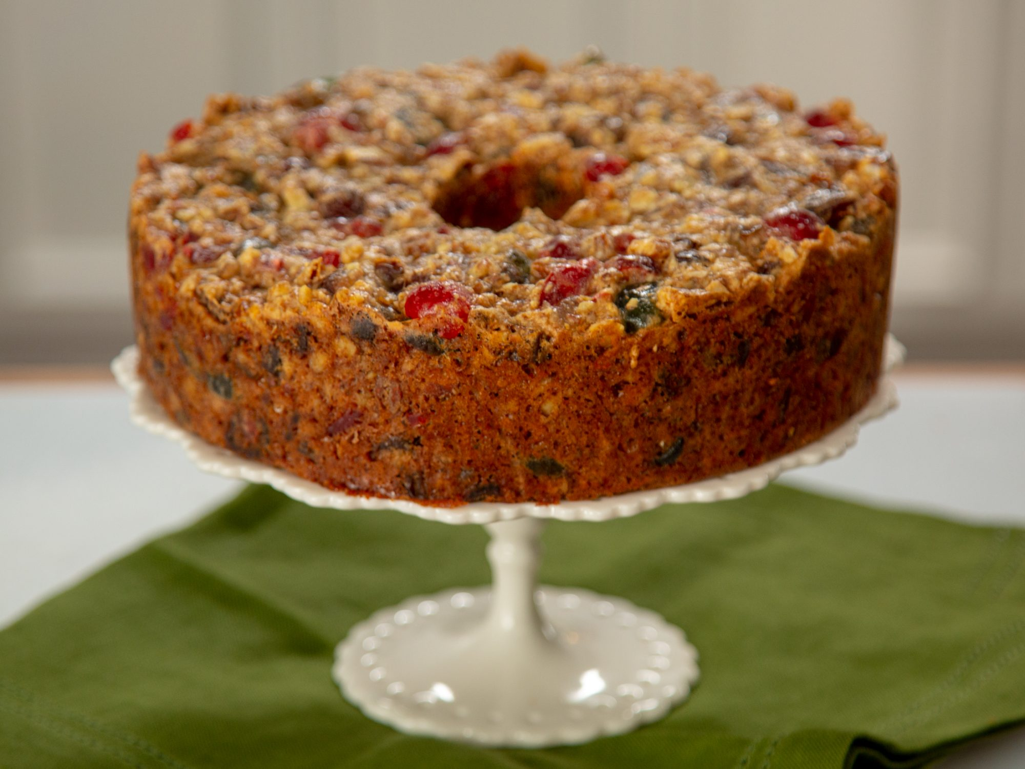 Grandma's Truly Delicious Fruitcake on a white stand