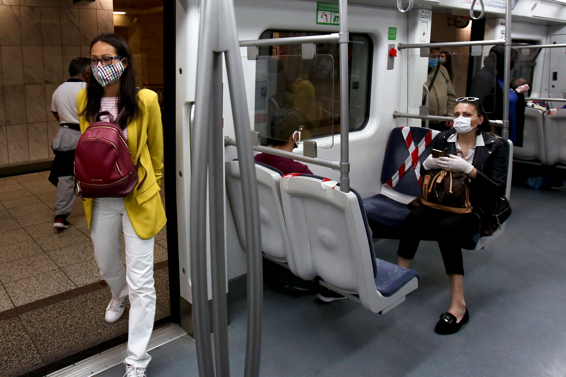 commuters wearing protective face masks on the Greece metro