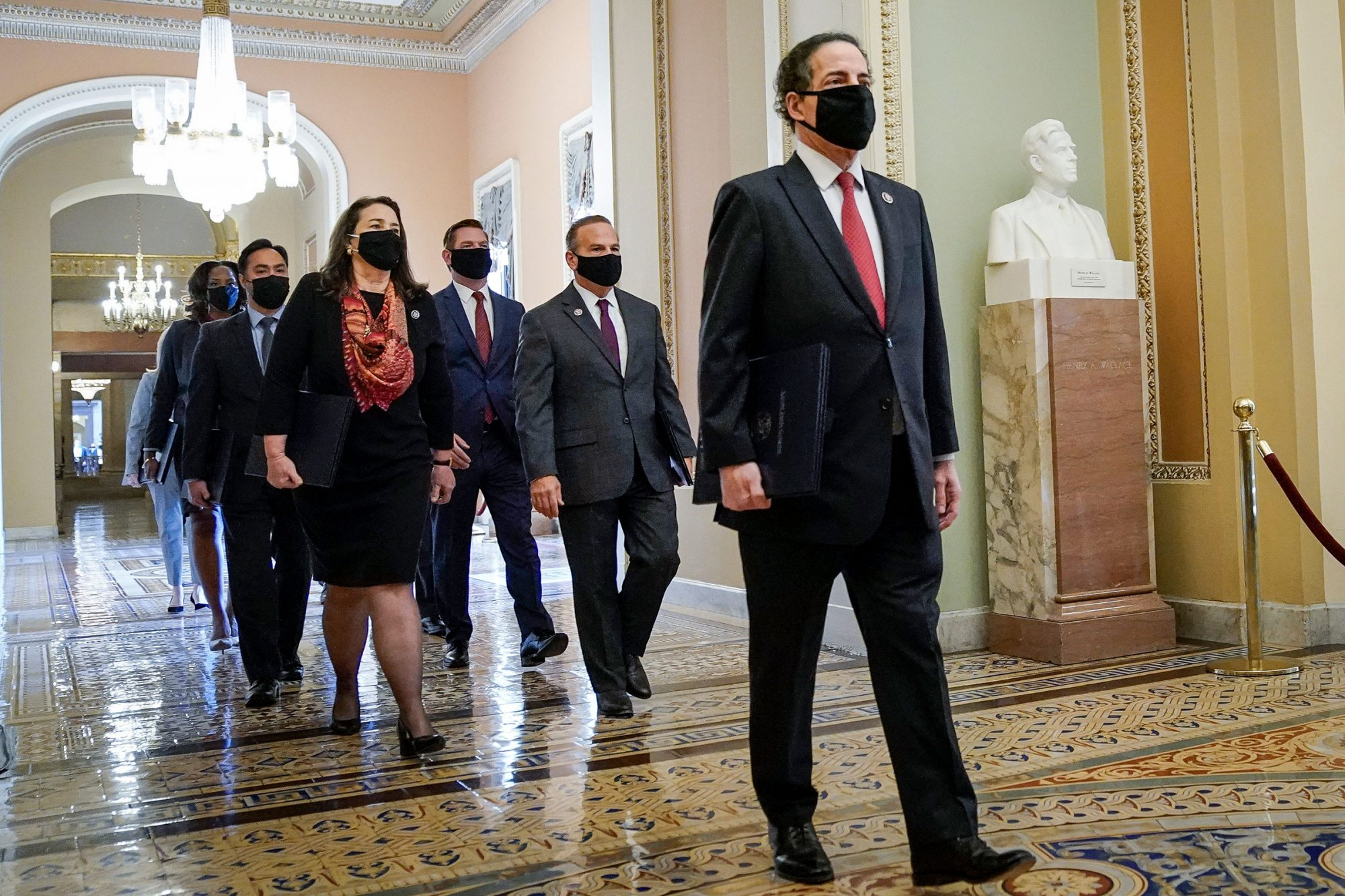 Led by lead manager Rep. Jamie Raskin (D-MD), House impeachment managers walk to the Senate Chamber on the first day of former President Donald Trump's second impeachment trial at the U.S. Capitol on February 9, 2021