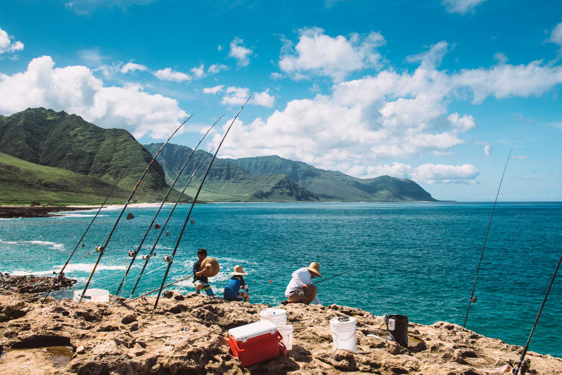 Hawaiian Family Fishing at Ka'ena Point in Oahu
