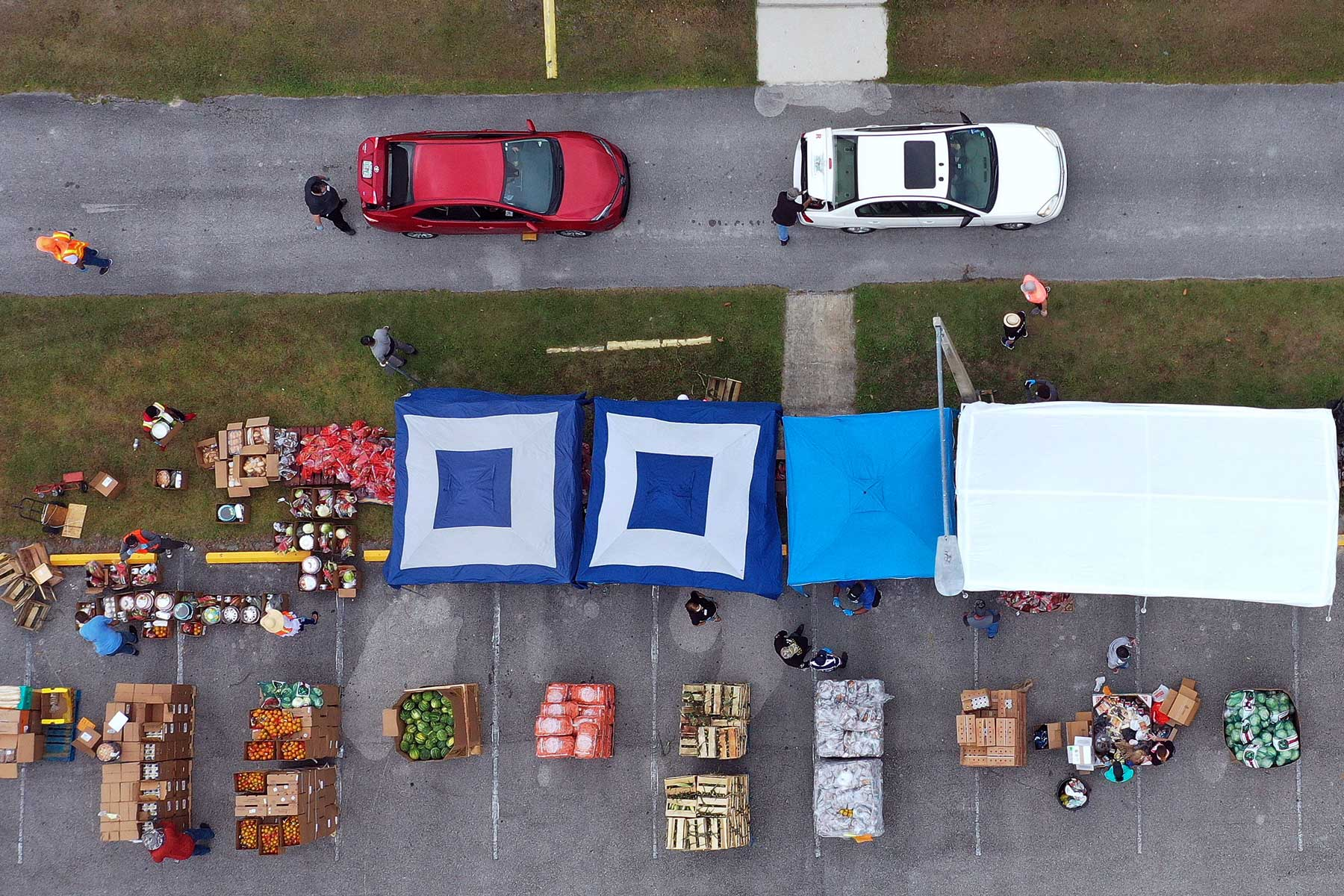 In this aerial view, volunteers distribute food from the Second Harvest Food Bank of Central Florida