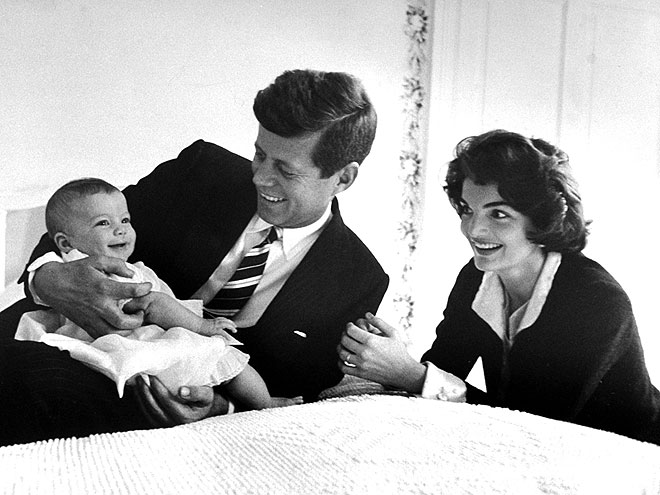 March 25, 1958: Sen. Jack Kennedy cuddling his darling baby daughter Caroline who is smiling as her mom Jackie looks on in delight while relaxing on bed at home. (Photo by Ed Clark/Time Life Pictures/Getty