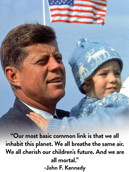 Presidential candidate John F. Kennedy (L) holding daughter Caroline (R) outdoors on Election Day.