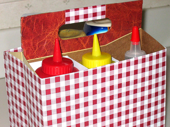 USE A SIX-PACK CONTAINER TO CORRAL CONDIMENTS