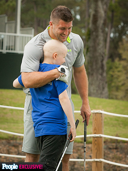Tim Tebow and a young fan