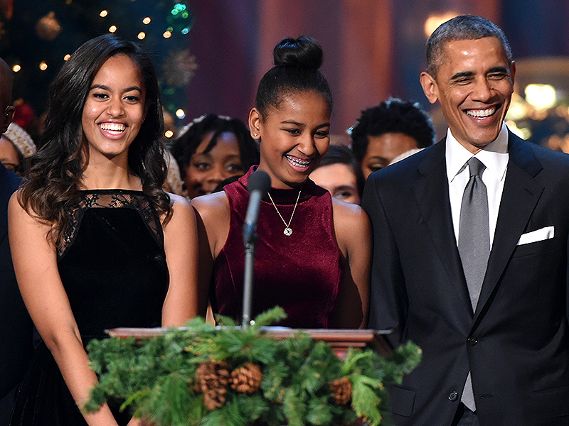 Malia Obama, Sasha Obama, and U.S. President Barack Obama speak onstage at TNT Christmas in Washington 2014 at the National Building Museum on December 14, 2014 in Washington, DC.