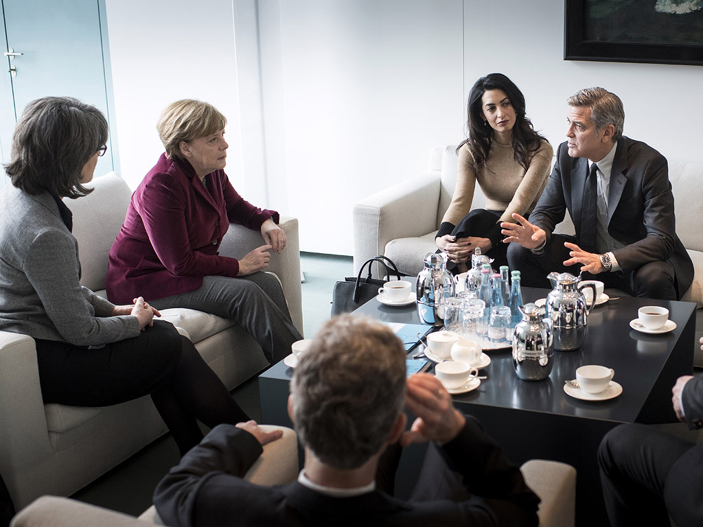 –Chancellor Angela Merkel (2nd L) meets with George Clooney and Amal Clooney (2nd R) at the Federal Chancellery to talk about refugee policy and Germany's commitment to the International Rescue Committee, on February 12, 2016 in Berlin, Germany.