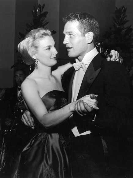 Married American actors Paul Newman and Joanne Woodward share a dance as Woodward holds her Best Actress Oscar statuette, during the Academy Awards