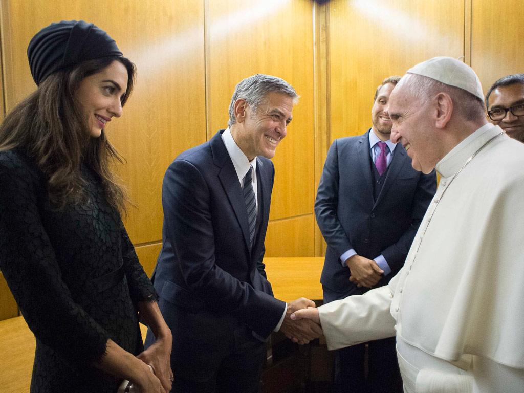 Pope Francis meets actor George Clooney and his wife Amal, at a meeting with the Scholas Occurrentes, an educational organization founded by Pope Francis, at the Vatican, Sunday, May 29, 2016.