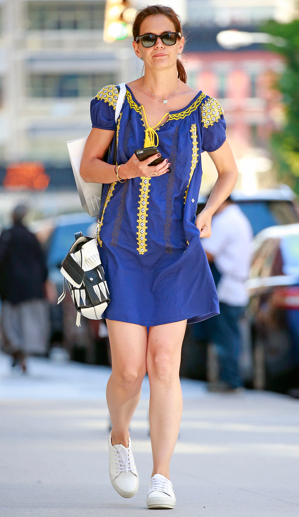 EXCLUSIVE: Katie Holmes seen texting on her phone and seen carrying an Intermix shopping bag in Tribeca, New York City