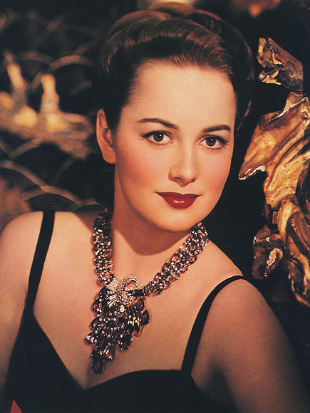 1940: The movie actress OLIVIA DE HAVILLAND ( born in Tokyo , Japan 1916 ) in a publicity still - CINEMA - FILM Archivio GBB / CONTRASTO