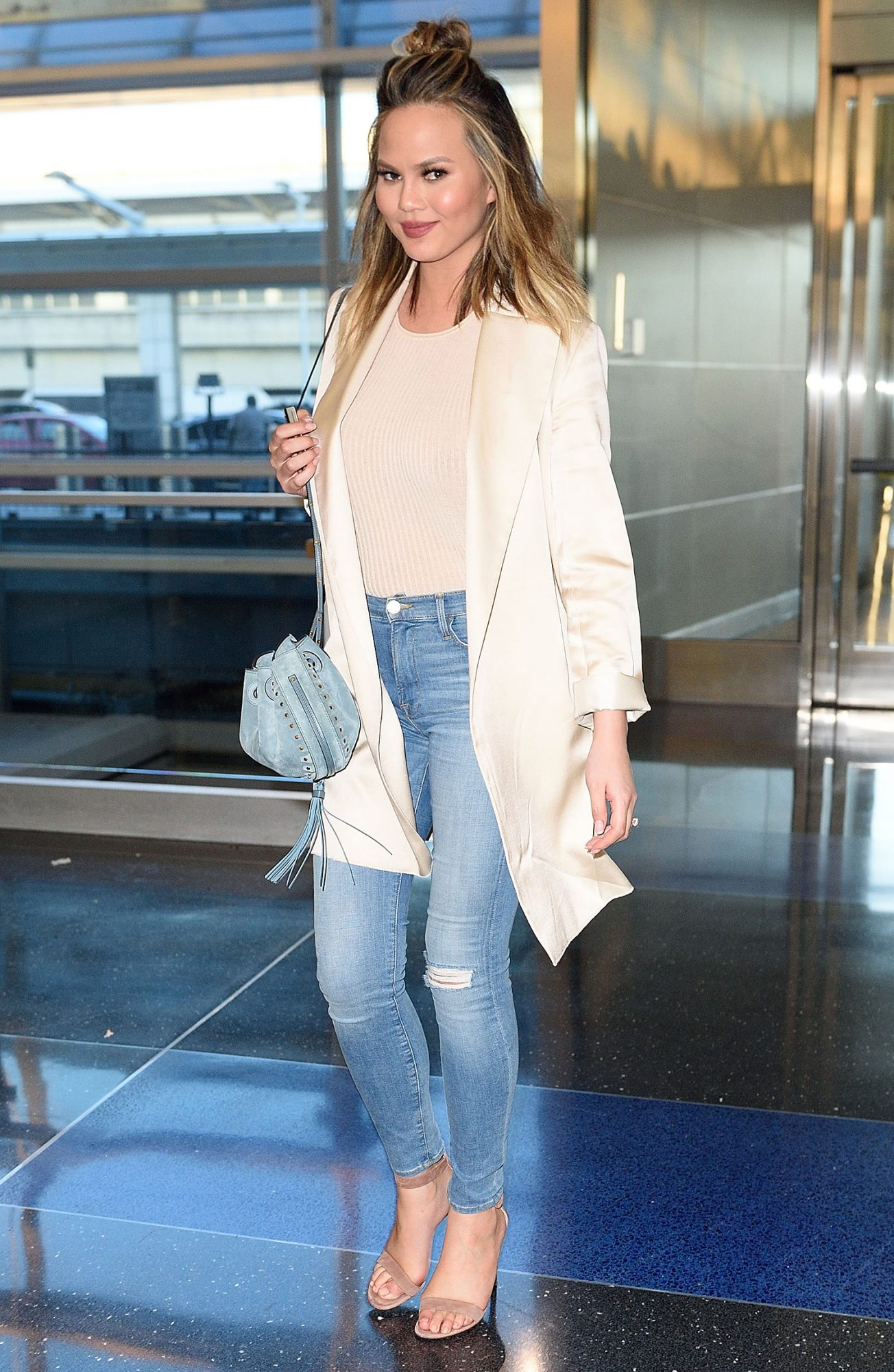 Chrissy Teigen gives a Smile at JFK Airport