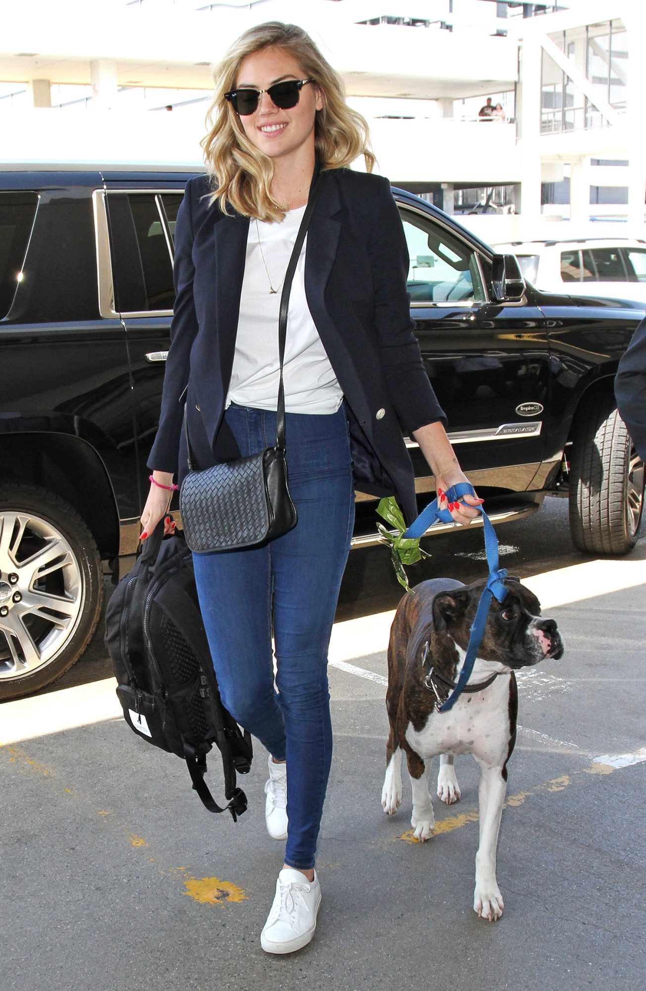 Kate Upton catches a flight out of Los Angeles with her dog Harley.  The supermodel was seen flying out of LAX.