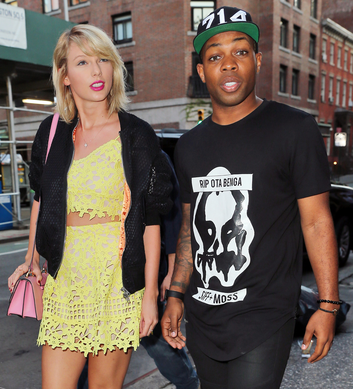Taylor Swift out and about wearing a flirty yellow mini skirt bearing her midriff when out to dinner with Todrick Hall