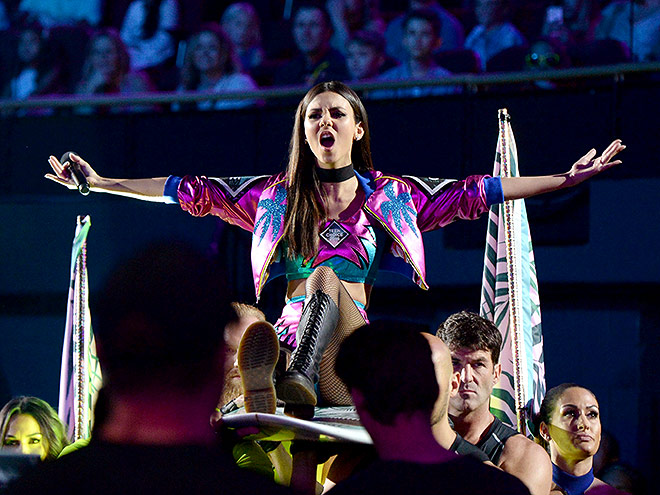VICTORIA JUSTICE WAS CARRIED IN ON A SURFBOARD
