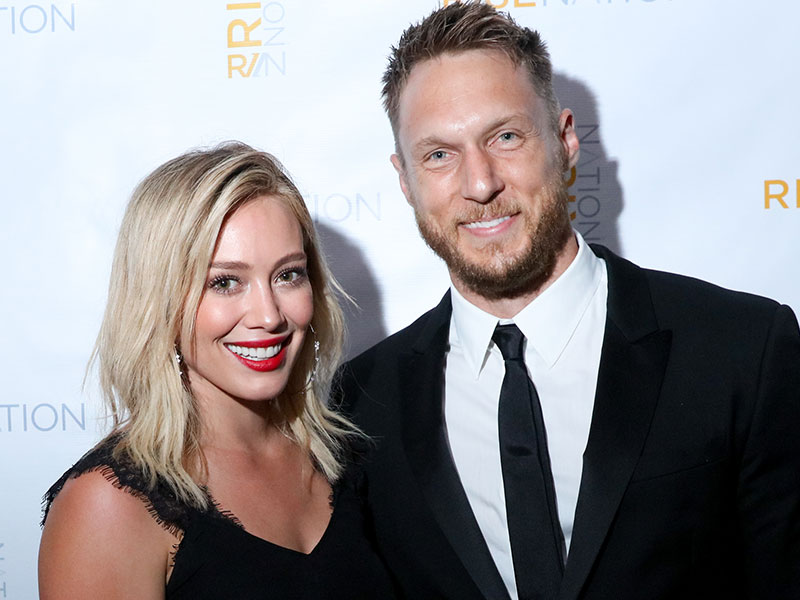 WEST HOLLYWOOD, CA - AUGUST 21: Actress Hilary Duff and personal/celebrity trainer Jason Walsh attend 'Rise Nation Fitness Studio's Los Angeles Grand Opening' on August 21, 2015 in West Hollywood, California.