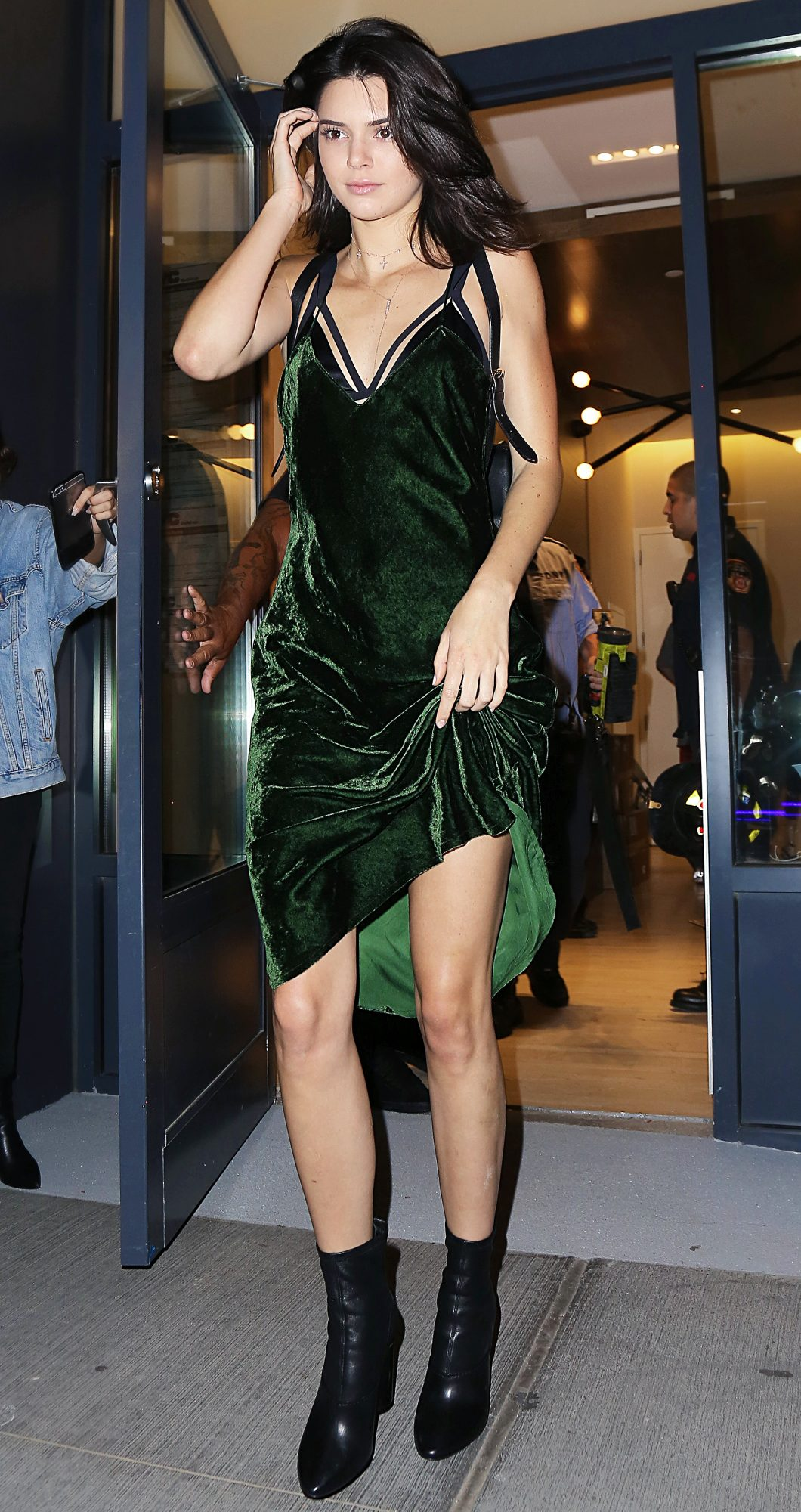Kendall Jenner steps out in green dress and boots in NYC