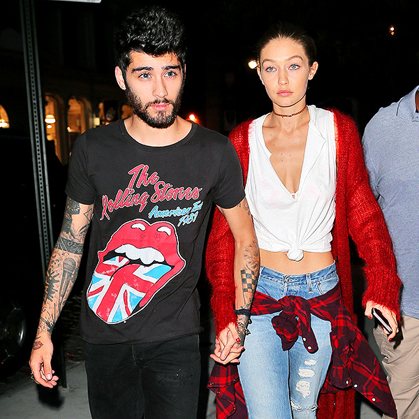 Zayn Malik holds Gigi Hadid's hand as they walk back to their apartment in New York. Pictured: Zayn Malik,Gigi Hadid Picture by: Jackson Lee / Splash News