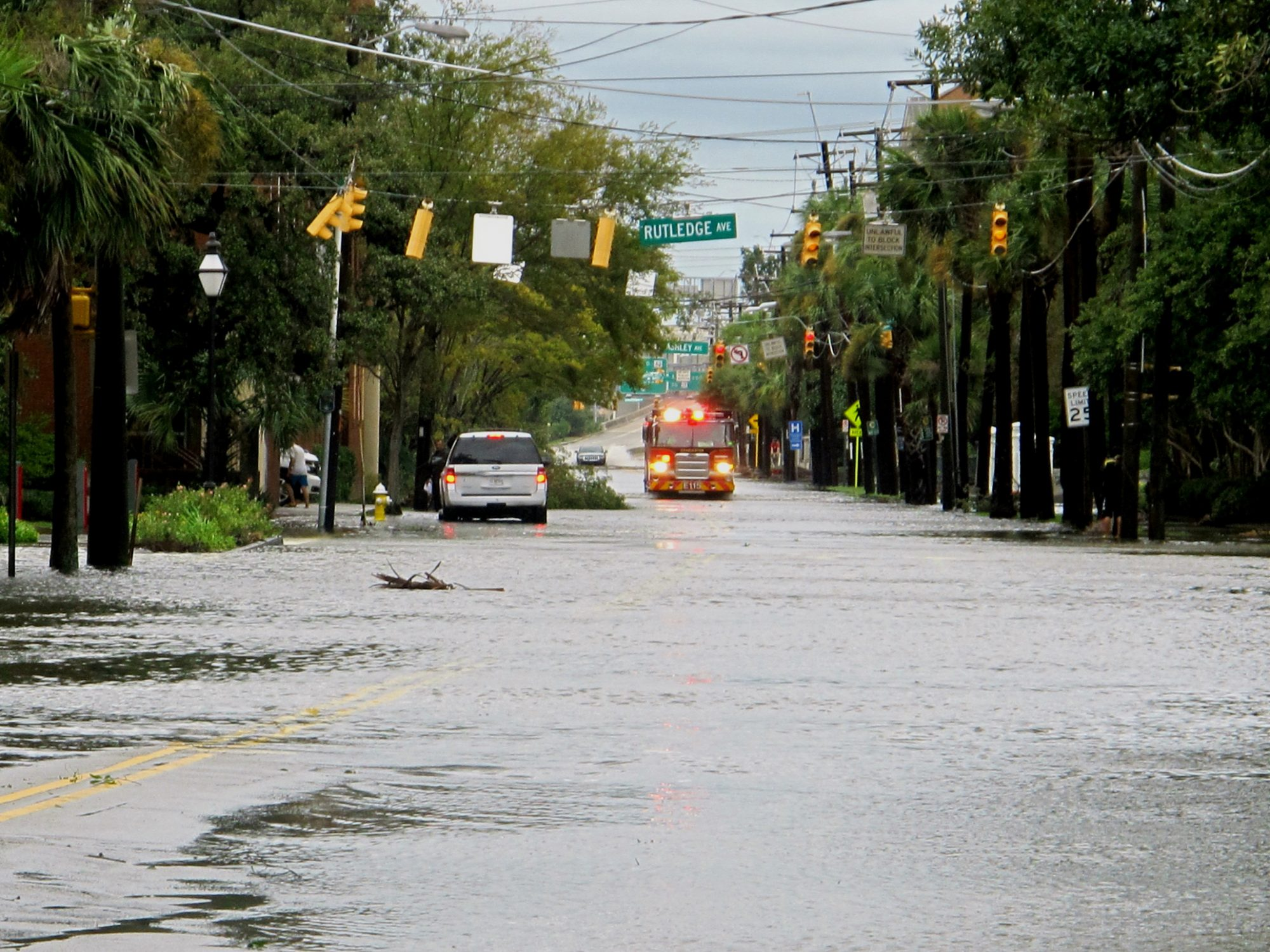 A firetruck drives through a flooded street in the hospital district of Charleston, S.C., on Saturday, Oct. 8, 2016 after Hurricane Matthew passed through. Most of the damage in the city was downed trees and street flooding and officials said 100 streets were closed because of high water.