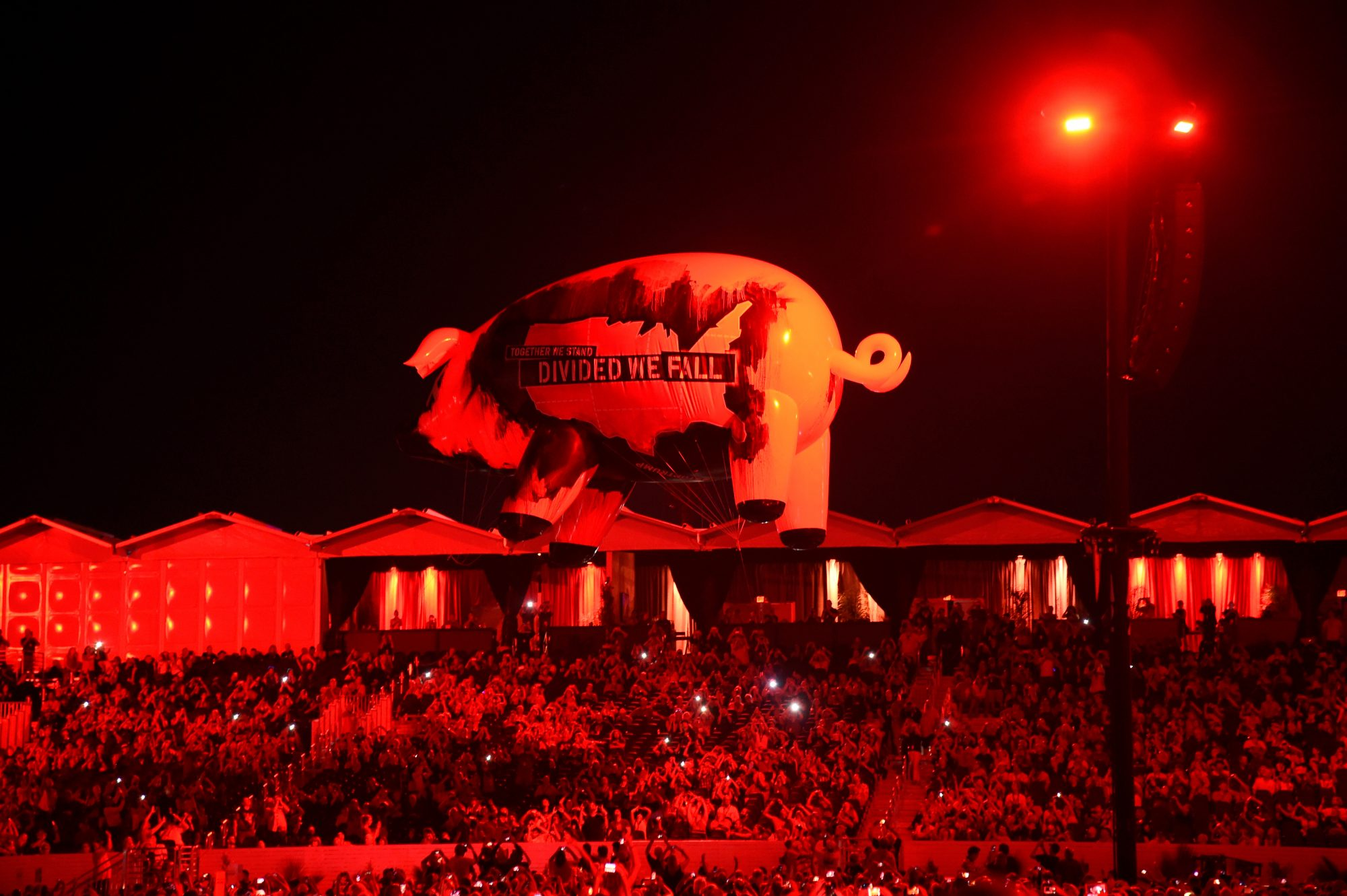 "INDIO, CA - OCTOBER 09: ""Divided We Fall"" Pig floats over the audience during the Roger Waters performance at Desert Trip at The Empire Polo Club on October 9, 2016 in Indio, California. (Photo by Kevin Mazur/Getty Images for Desert Trip)"