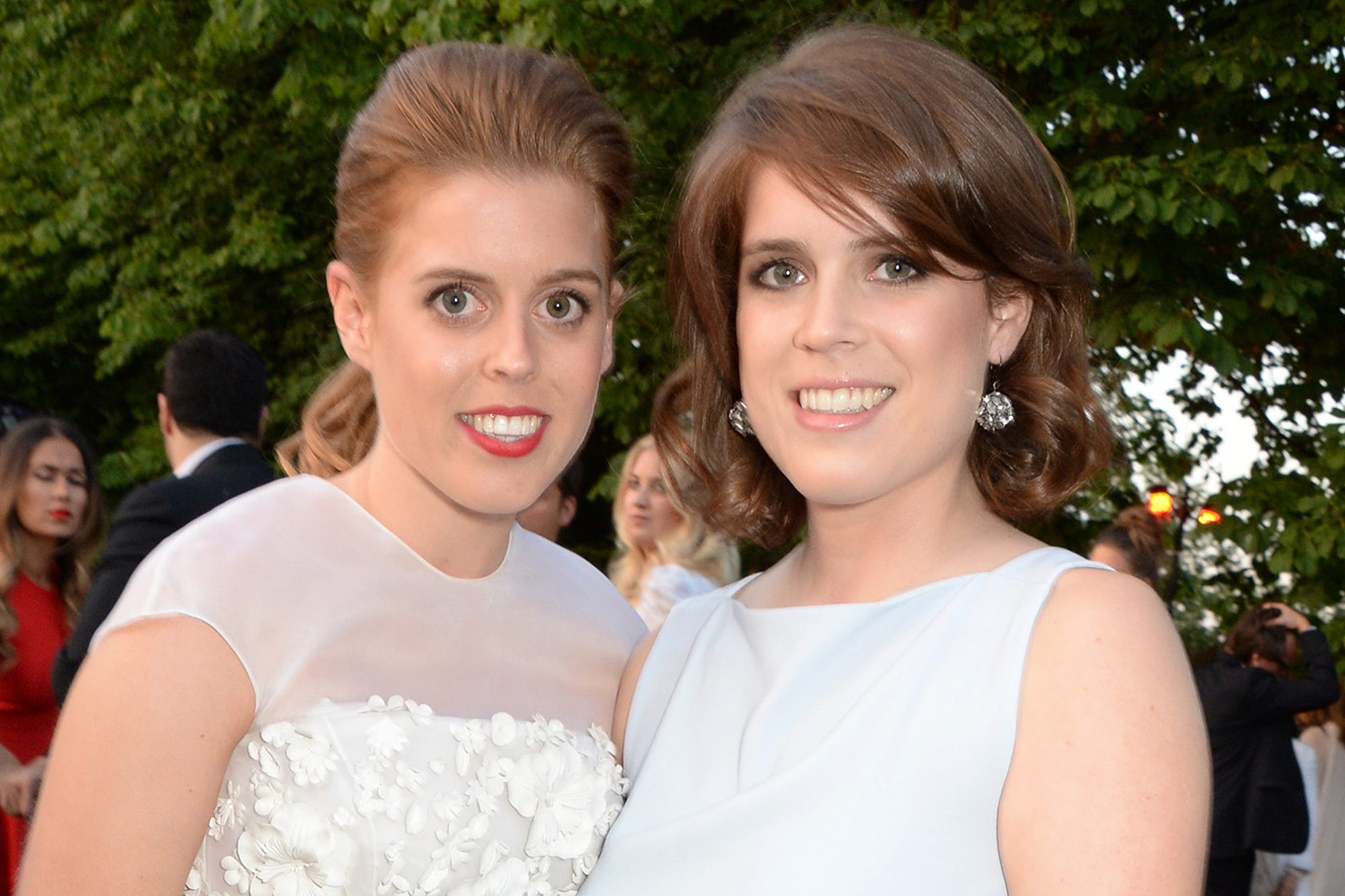 LONDON, ENGLAND - JULY 01: Princess Beatrice of York (L) and Princess Eugenie of York attend The Serpentine Gallery Summer Party co-hosted by Brioni at The Serpentine Gallery on July 1, 2014 in London, England. (Photo by David M. Benett/Getty Images for The Serpentine)