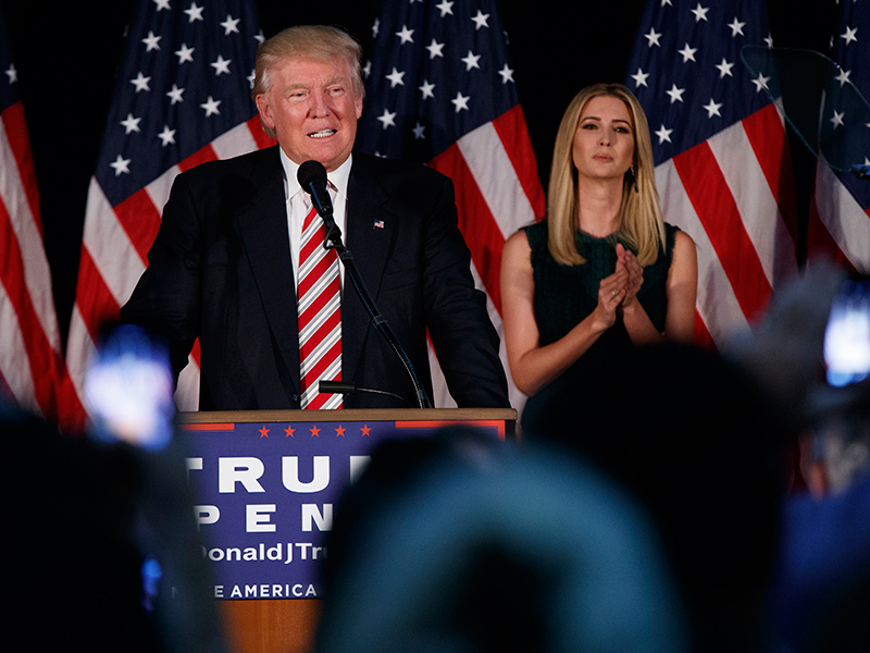 Ivanka Trump, right, listens as her father Republican presidential candidate Donald Trump delivers a policy speech on child care, Tuesday, Sept. 13, 2016, in Aston, Penn. (AP Photo/Evan Vucci)