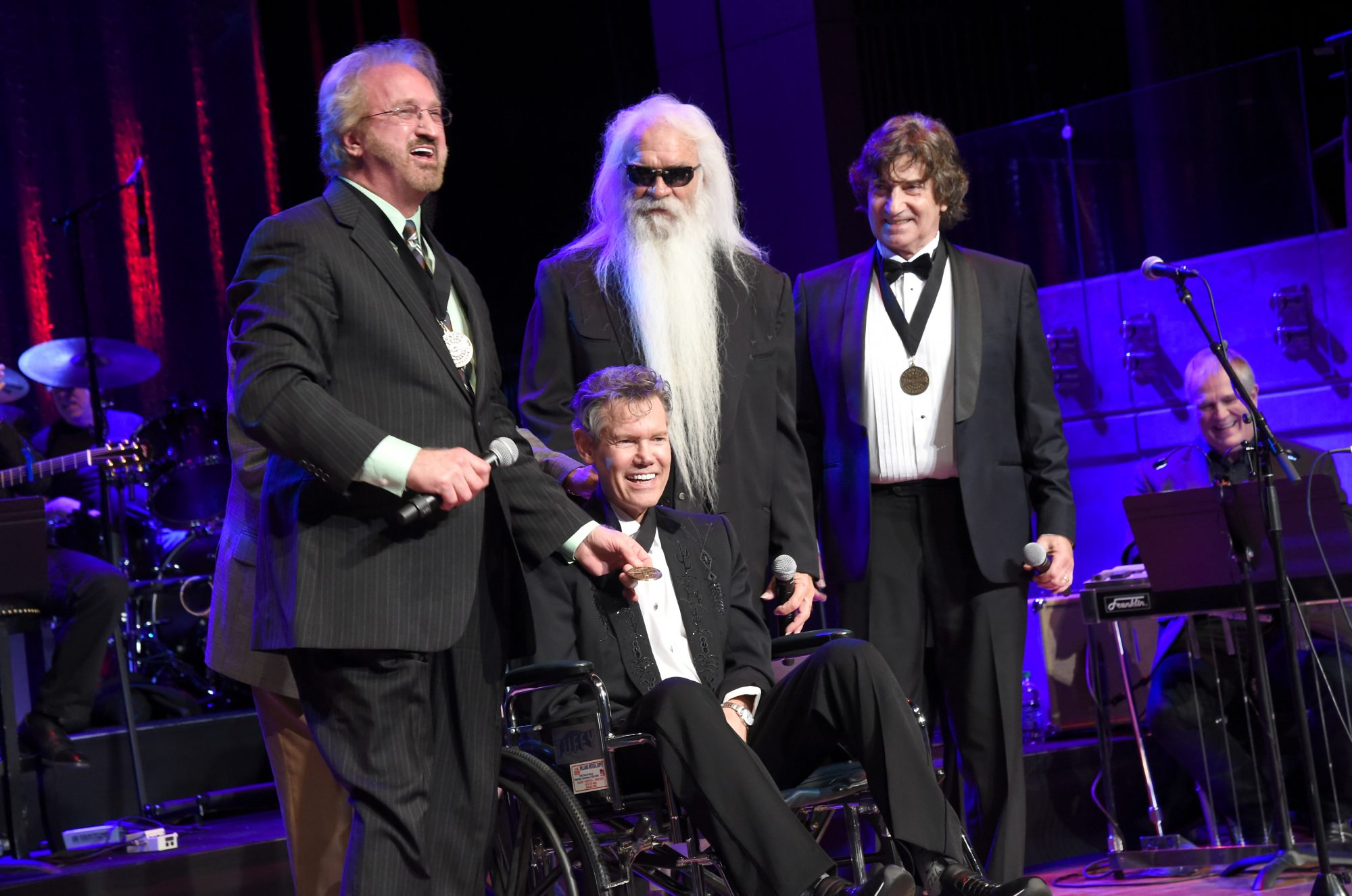 NASHVILLE, TN - OCTOBER 16:  Duane Allen, William Lee Golden, and Richard Sterban of The Oak Ridge Boys and Charley Pride perform onstage with inductee Randy Travis during the 2016 Medallion Ceremony at Country Music Hall of Fame and Museum on October 16, 2016 in Nashville, Tennessee.  (Photo by Rick Diamond/Getty Images for Country Music Hall of Fame & Museum)