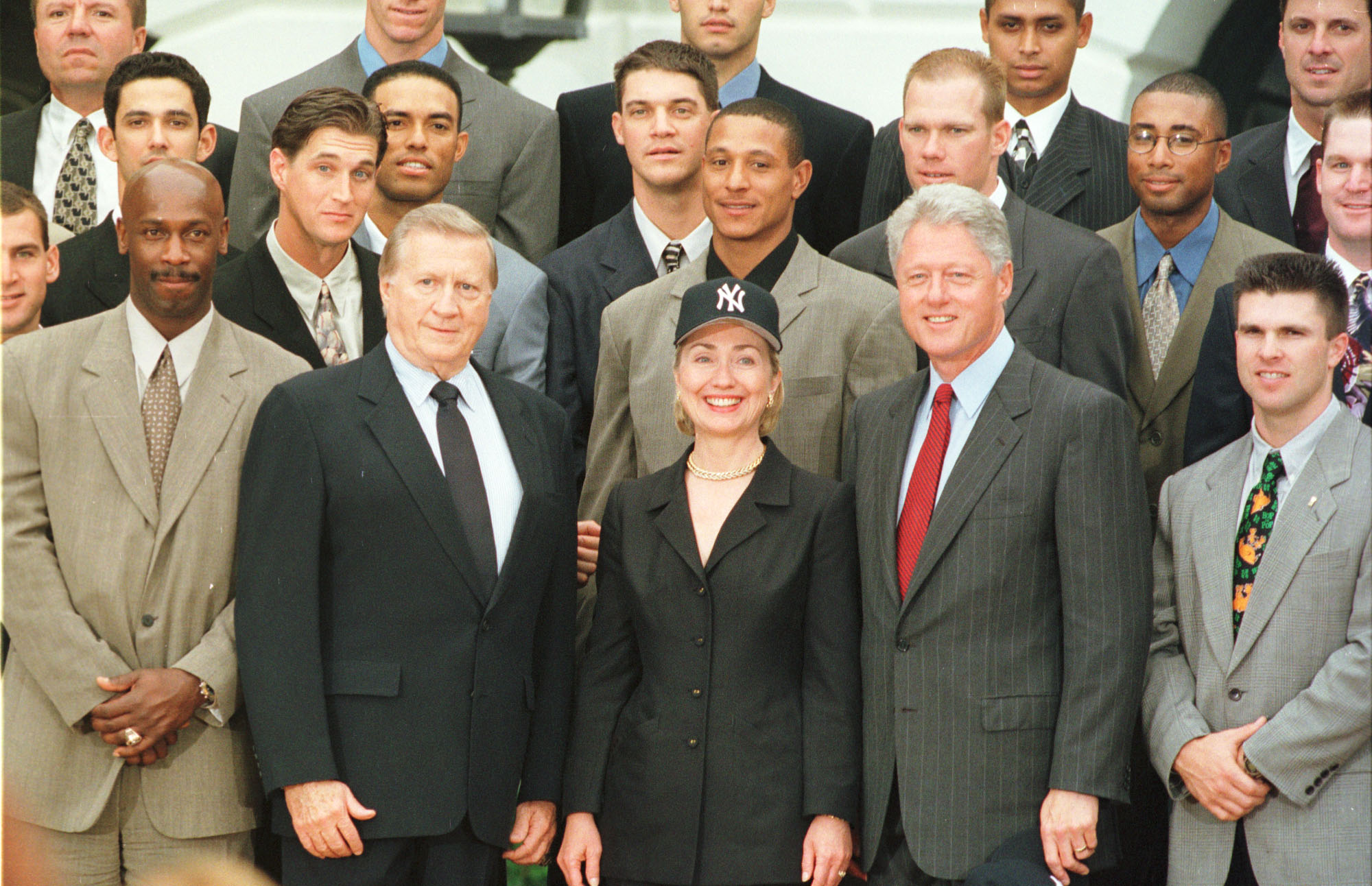President Bill Clinton, first lady Hillary Rodham Clinton and Yankees owner George M. Steinbrenner III (L) pose with members of the team as the 1998 World Series winning Yankees were invited to the White House June 10, 1999 in Washington, DC. (photo by Richard Ellis)