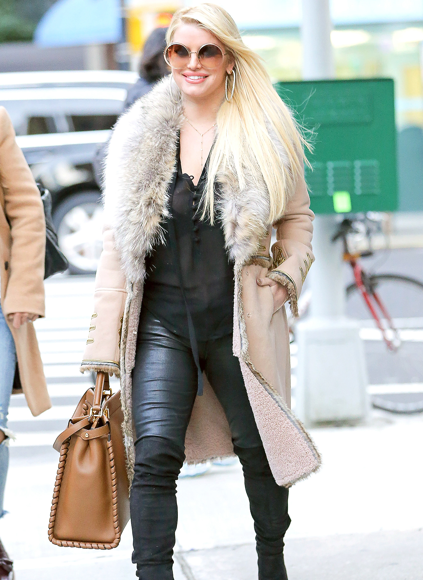 Jessica Simpson is all smiling while leaving Rosa Mexicano restaurant in New York City