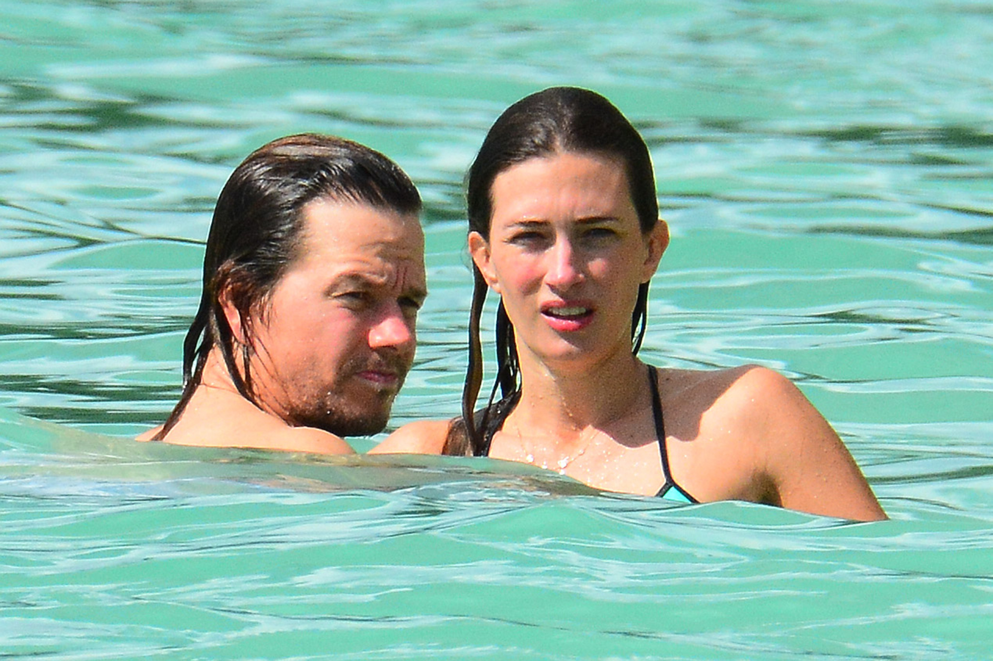 Mark Wahlberg and wife Rhea spotted relaxing and enjoying a swim at the beach while on holiday in Barbados. Pictured: Mark Wahlberg, Rhea Durham Ref: SPL1375489 171016 Picture by: Shanice King/246paps/Splash News Splash News and Pictures Los Angeles:310-821-2666 New York: 212-619-2666 London: 870-934-2666 photodesk@splashnews.com