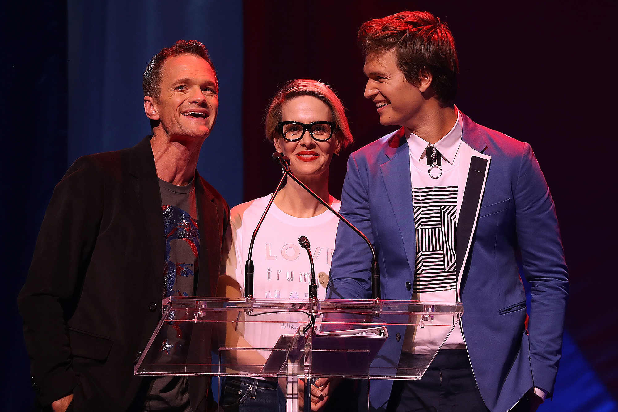 NEW YORK, NY - OCTOBER 17: (L-R) Actors Neil Patrick Harris, Sarah Paulson and Ansel Elgort appear on stage during the Hillary Victory Fund - Stronger Together concert at St. James Theatre on October 17, 2016 in New York City. Broadway stars and celebrities performed during a fundraising concert for the Hillary Clinton campaign. (Photo by Justin Sullivan/Getty Images)