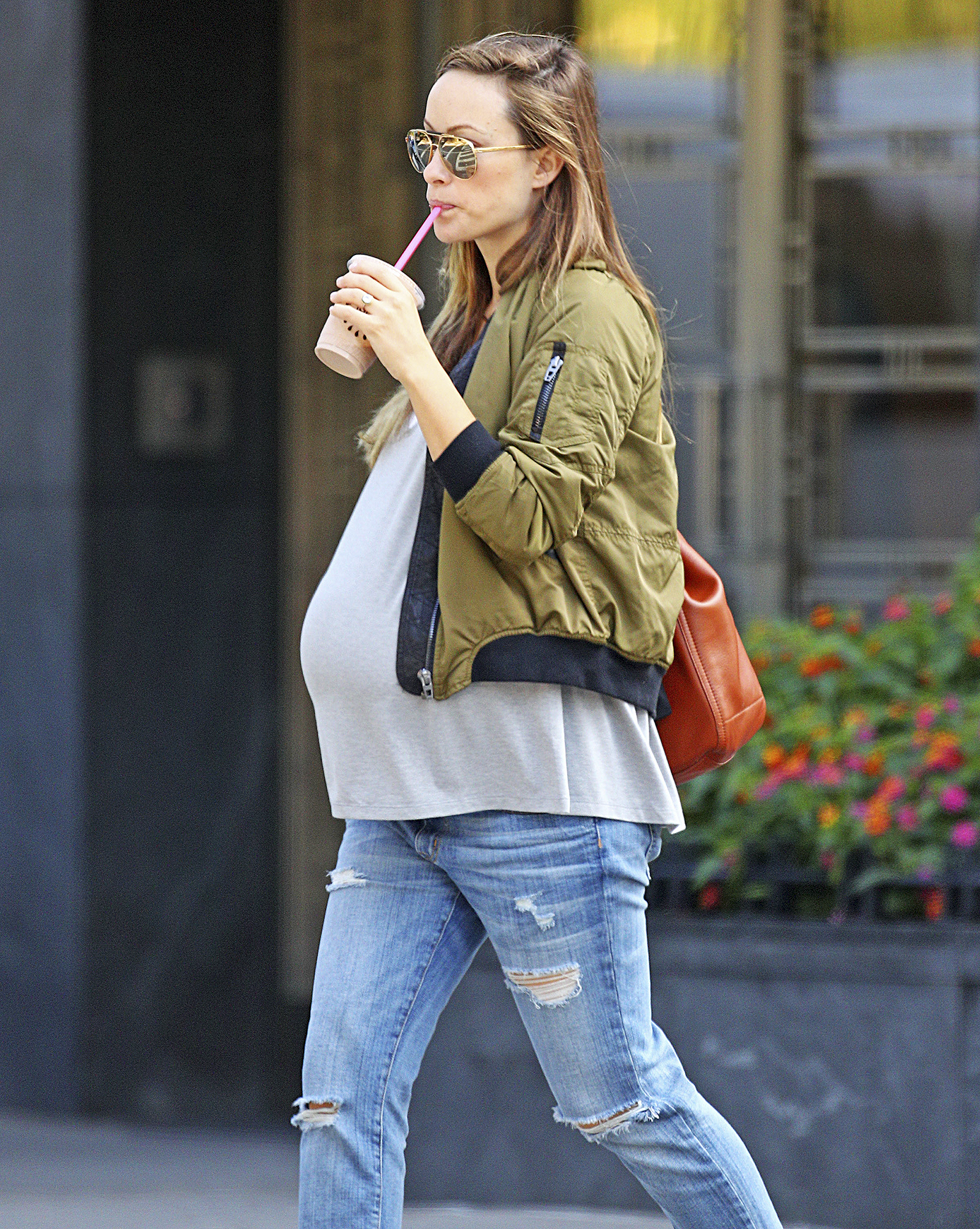 *EXCLUSIVE* Olivia Wilde shows off her massive baby bump as she relaxes in Central Park