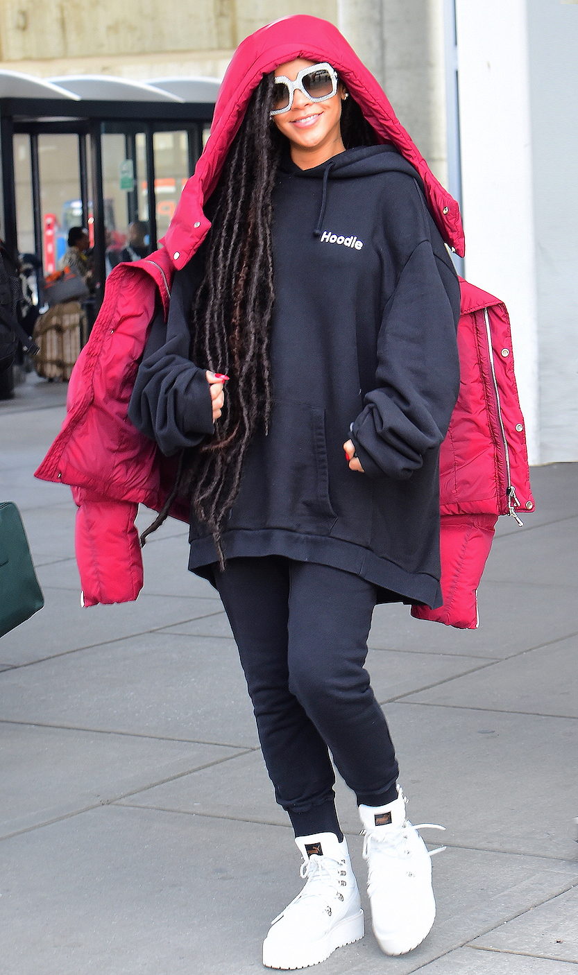 EXCLUSIVE: **PREMIUM EXCLUSIVE RATES APPLY ** Rihanna Lands Safely in NYC with Hip Length Dreads after Flying Out of Paris Immediately