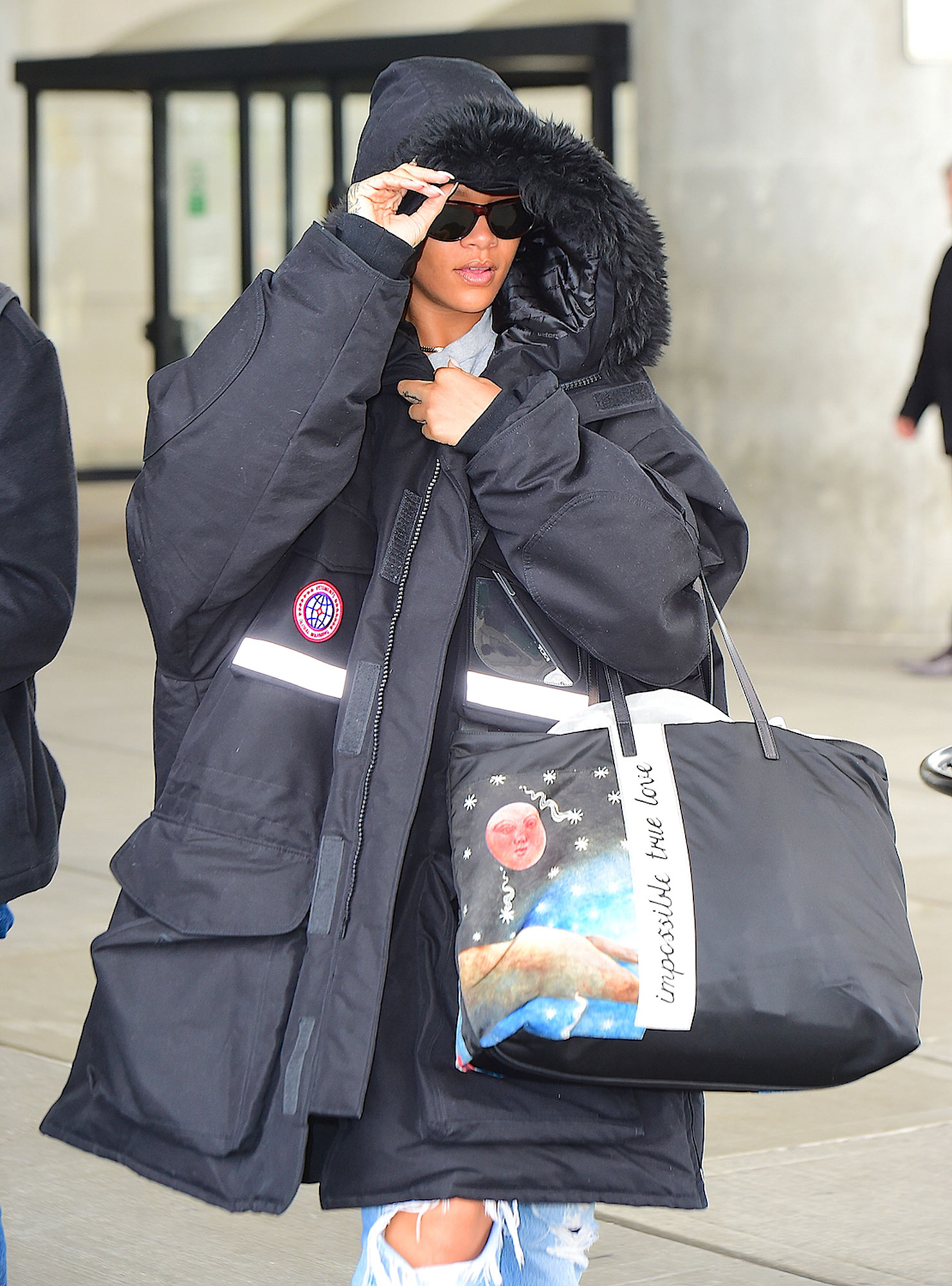 Rihanna Wears the World's Largest North Face Jacket as she flies into NYC from Paris