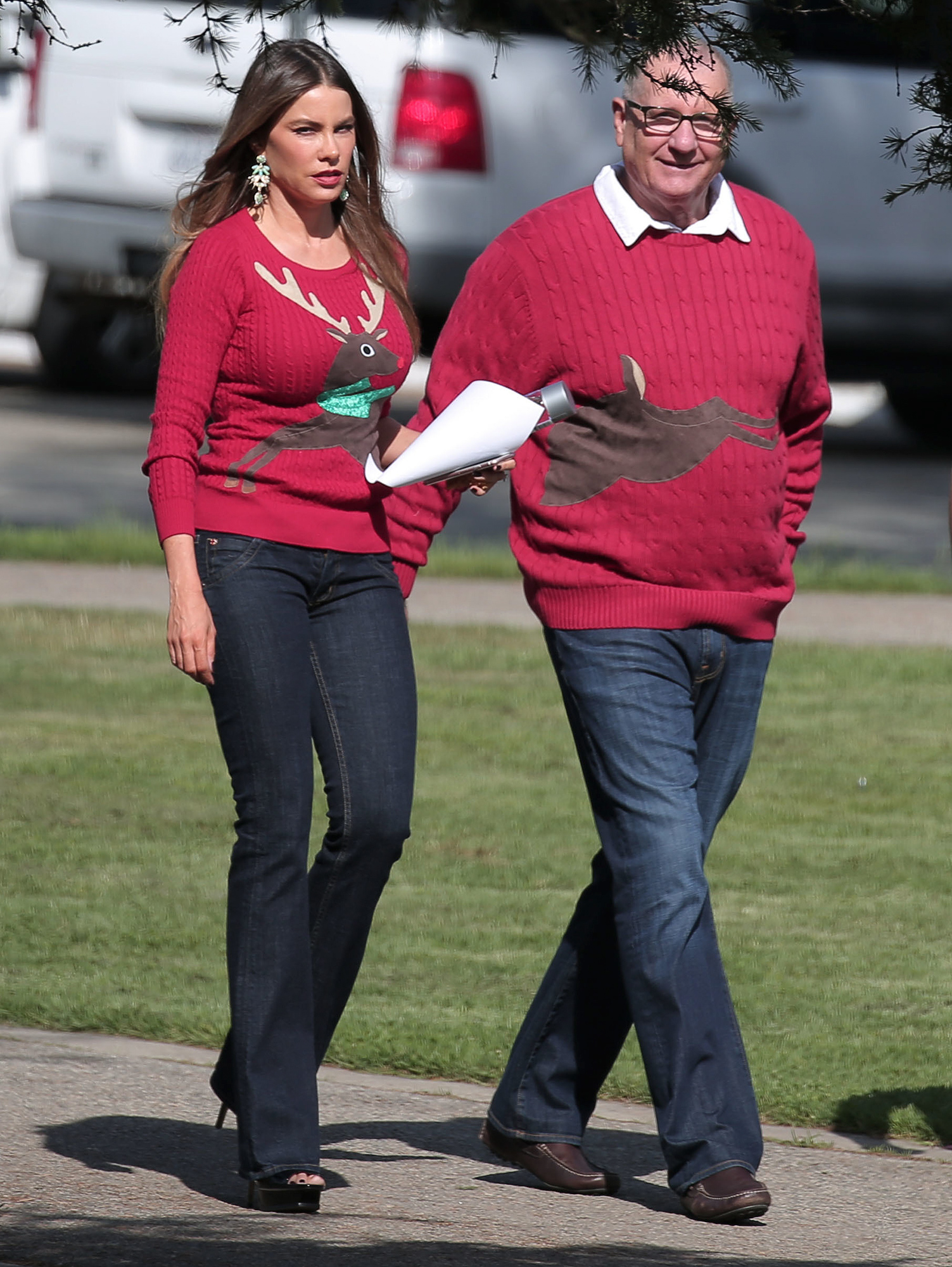 EXCLUSIVE: They complete each other. Sofia Vergara and Ed Oneill wear matching Christmas reindeer sweaters on the set of Modern Family filming in Los Angeles