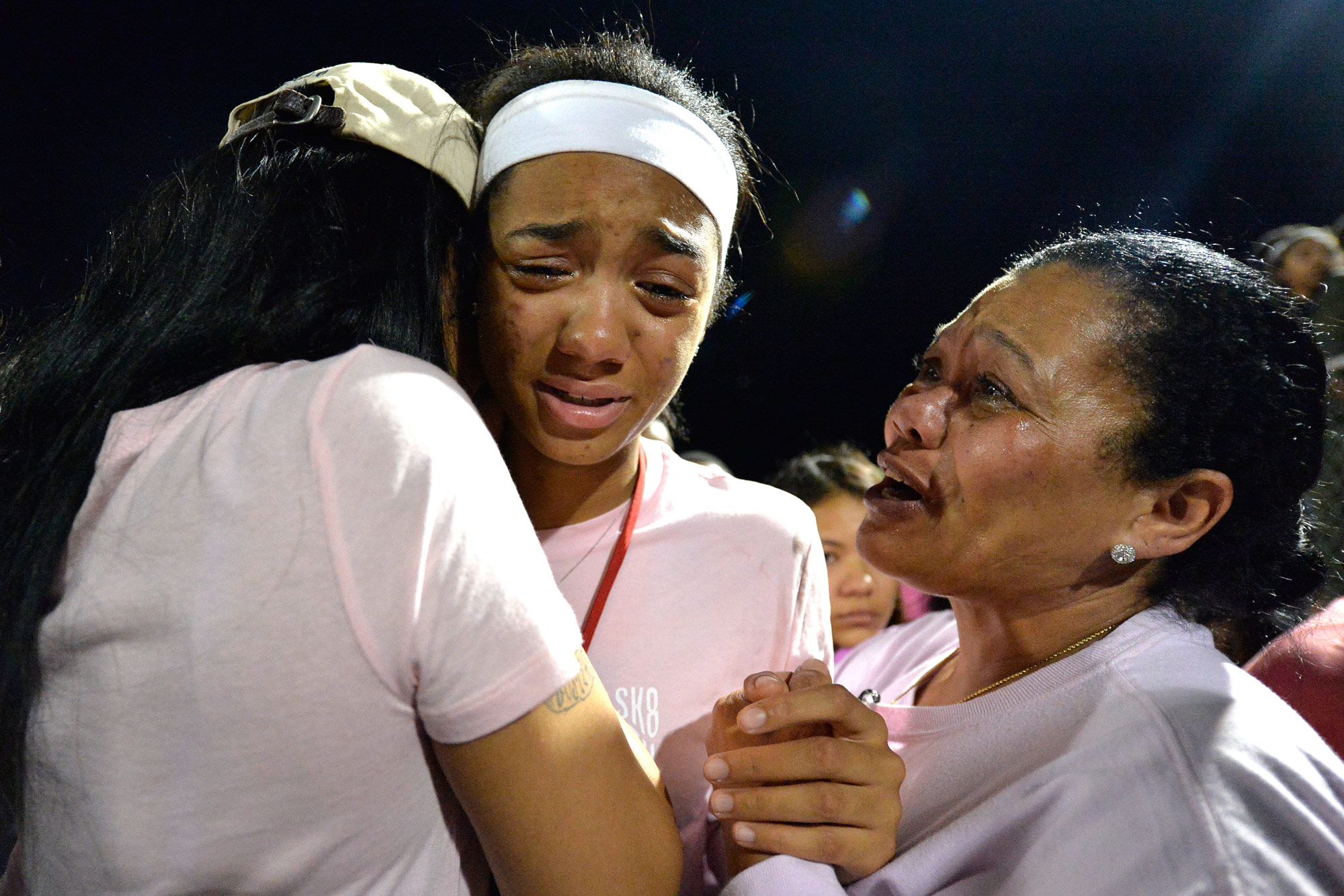 Classmates of Trinity Gay gathered in her memory at Lafayette High School, Monday, Oct. 17, 2016, in Lexington, Ky. Several thousand people, including Tyson Gay, turned out Monday night for a candlelight vigil in Kentucky to honor Gay's 15-year-old daughter, Trinity, who was fatally shot over the weekend.
