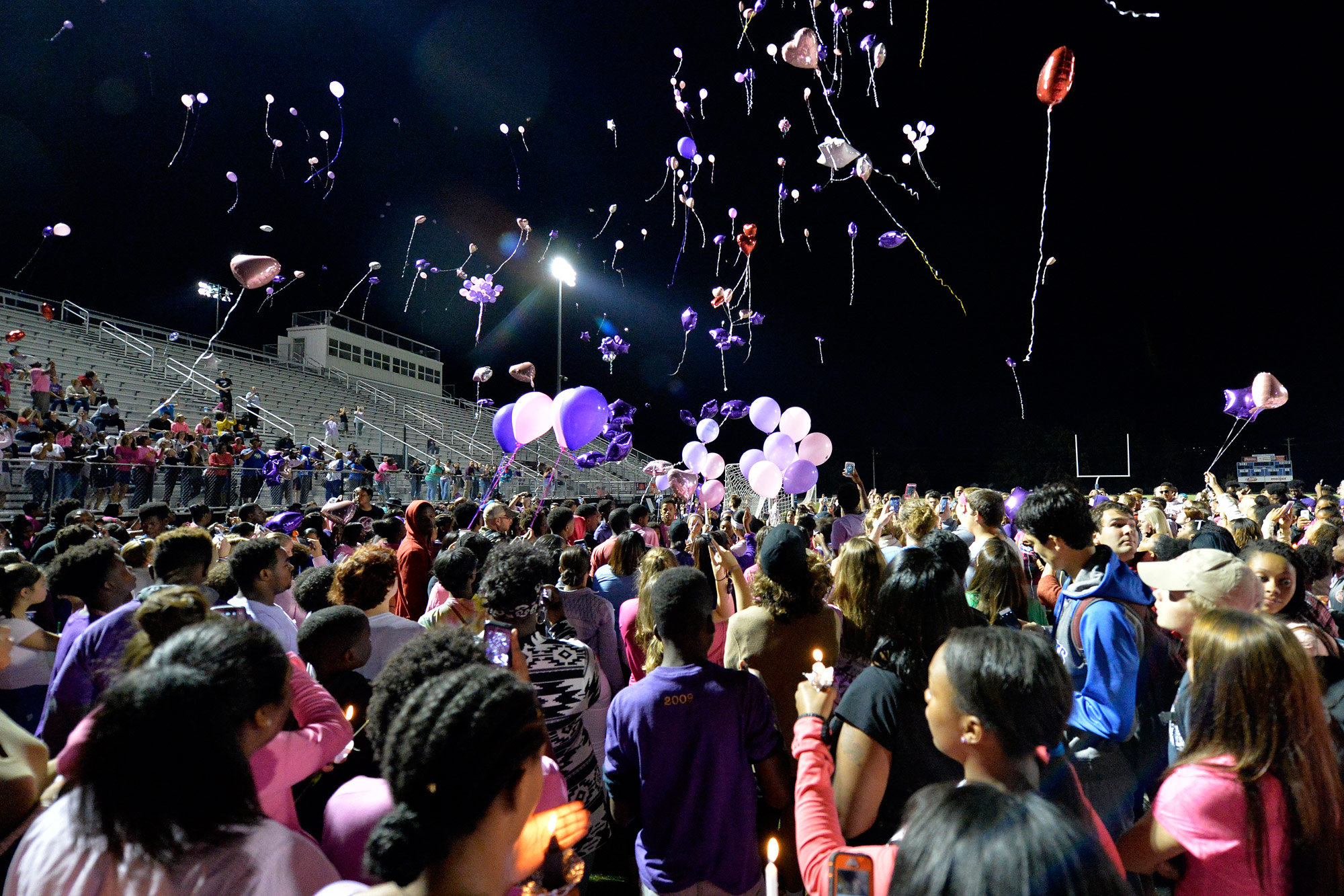 Classmates of Trinity Gay release balloons in her favorite colors in her memory at Lafayette High School, Monday, Oct. 17, 2016, in Lexington, Ky. Several thousand people, including Tyson Gay, turned out Monday night for a candlelight vigil in Kentucky to honor Gay's 15-year-old daughter, Trinity, who was fatally shot over the weekend.