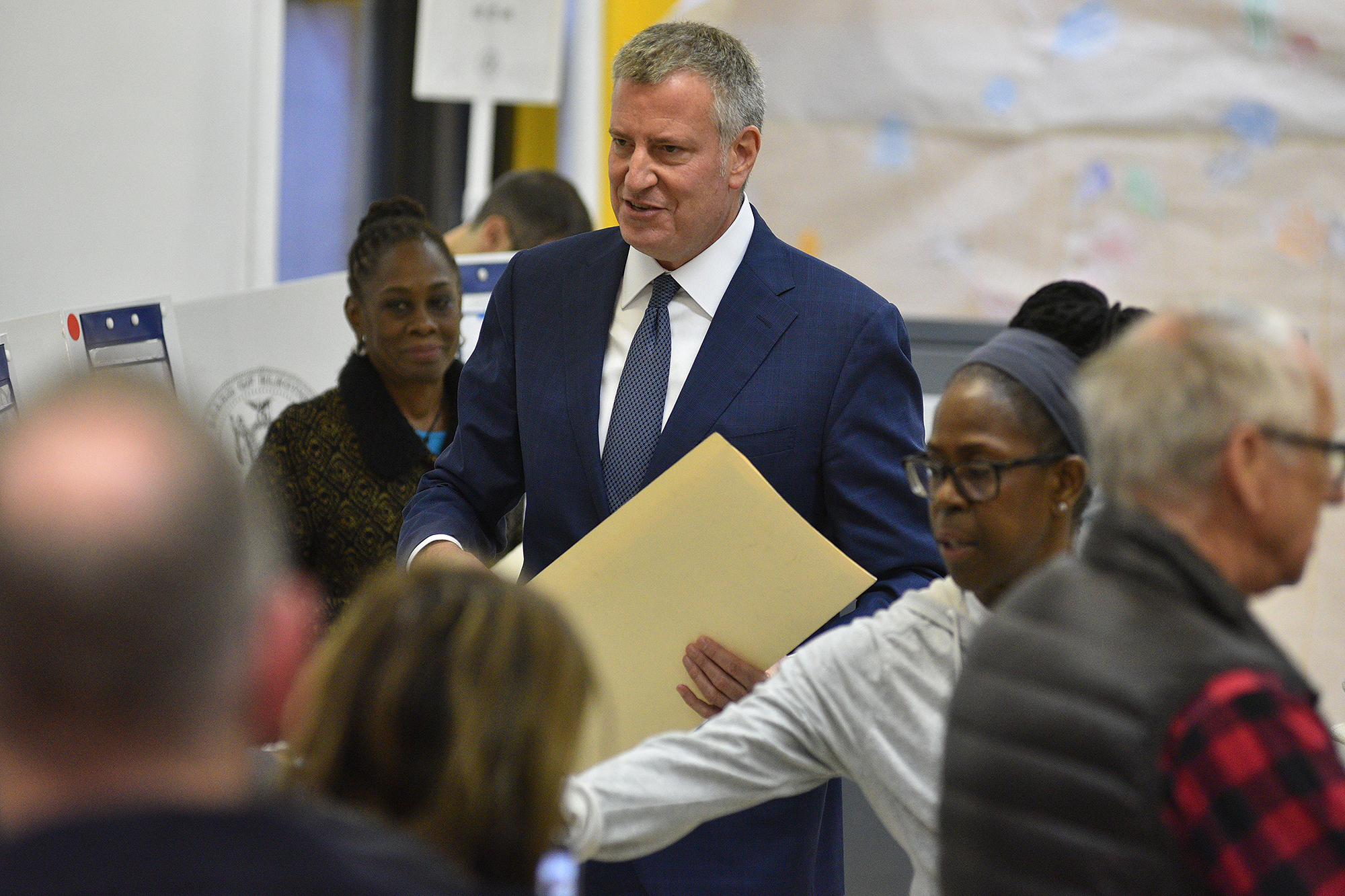 Mandatory Credit: Photo by Erik Pendzich/REX/Shutterstock (7426540i) Mayor Bill de Blasio prepares to cast his ballot in the US Presidential Election Voting in New York, USA - 08 Nov 2016 Bill De Blasio casted his vote at Park Slope Library at 431 6th Avenue, New York