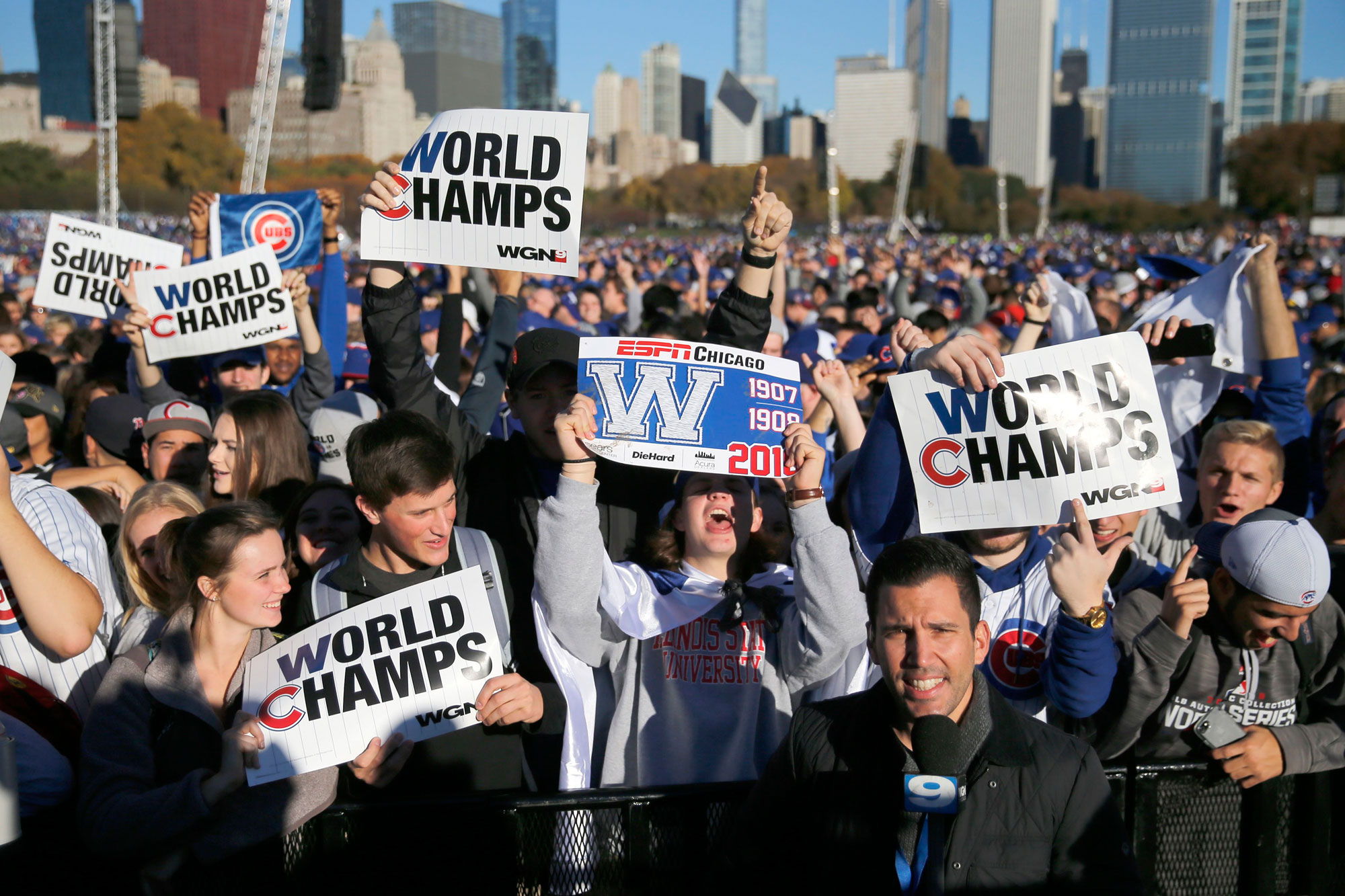 Chicago Cubs fans celebrate before a rally in Grant Park honoring the World Series baseball champions Friday, Nov. 4, 2016, in Chicago. (AP Photo/Charles Rex Arbogast)