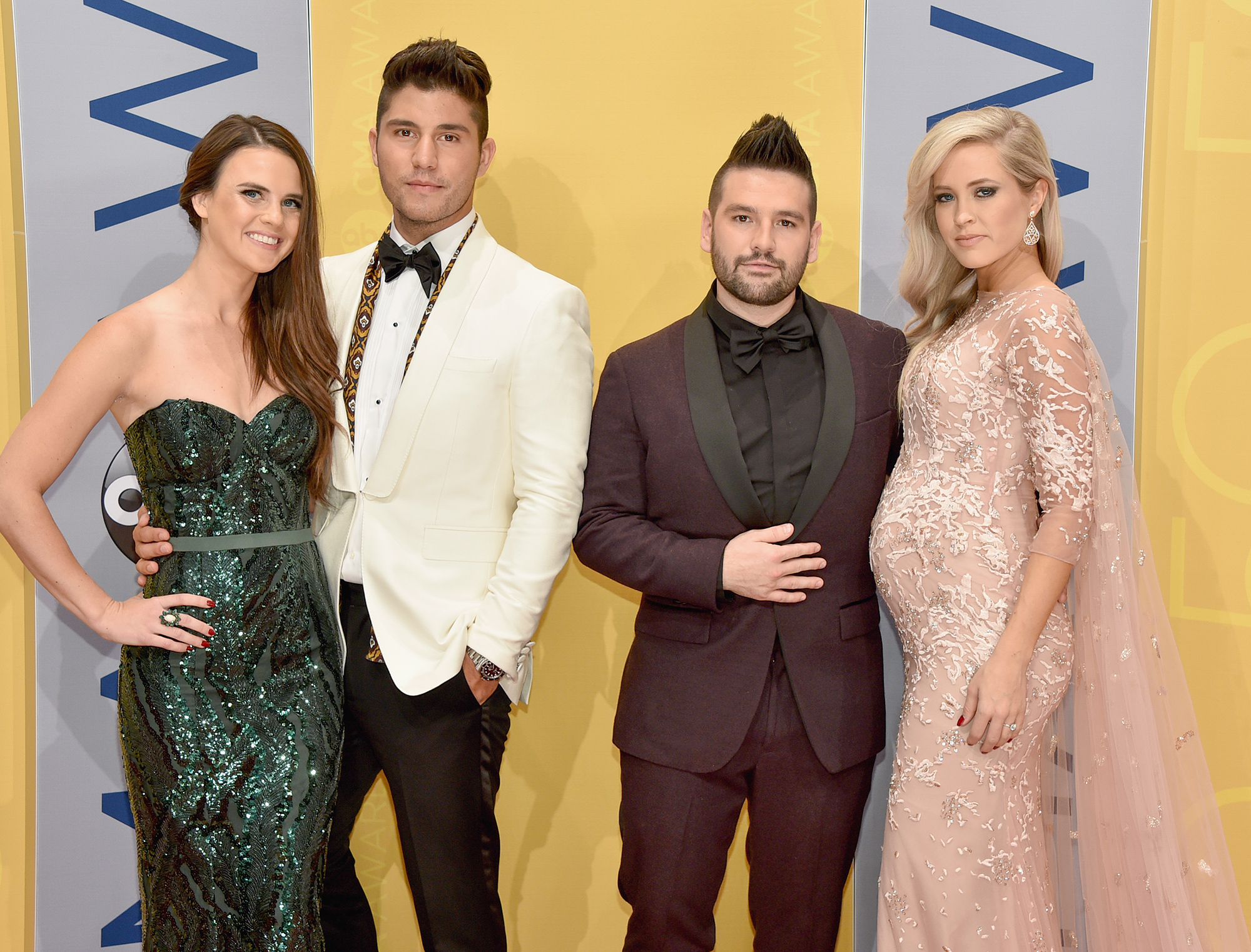 NASHVILLE, TN - NOVEMBER 02:  (L-R) Abby Law, Dan Smyers of Dan + Shay, Shay Mooney of Dan + Shay, and Hannah Billingsley attend the 50th annual CMA Awards at the Bridgestone Arena on November 2, 2016 in Nashville, Tennessee.  (Photo by John Shearer/WireImage)