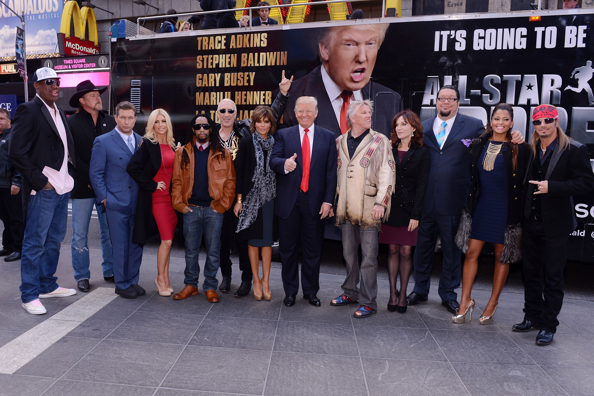 "NEW YORK, NY - OCTOBER 12: (L-R) Castmembers Dennis Rodman, Trace Adkins, Stephen Baldwin, Brande Roderick, Lil Jon, Dee Snider, Lisa Rinna, Donald Trump, Gary Busey, Marilu Henner, Penn Jillette, Claudia Jordan, and Brett Michaels attend the ""Celebrity Apprentice All Stars"" Season 13 Bus Tour at on October 12, 2012 in New York City. (Photo by Stephen Lovekin/Getty Images)"