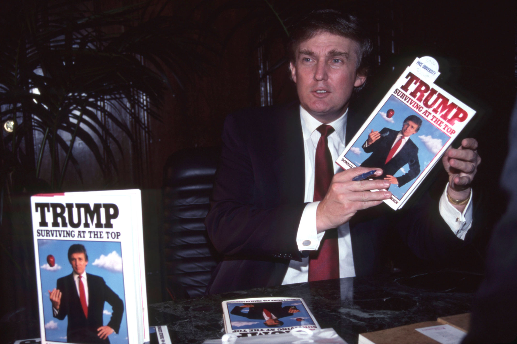 "NEW YORK - OCTOBER 1990: Donald Trump at signing for his book ""Trump: Surviving at the Top"" circa October 1990 in New York City. (Photo by Sonia Moskowitz/Getty Images)"