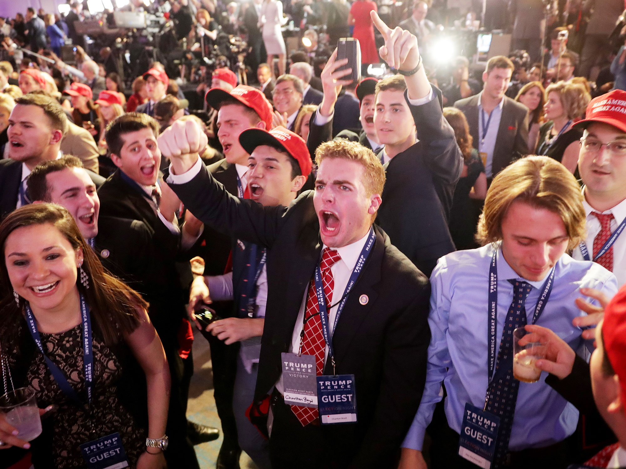 NEW YORK, NY - NOVEMBER 08: People cheer as voting results for Florida come in at Republican presidential nominee Donald Trump's election night event at the New York Hilton Midtown on November 8, 2016 in New York City. Americans today will choose between Republican presidential nominee Donald Trump and Democratic presidential nominee Hillary Clinton as they go to the polls to vote for the next president of the United States. (Photo by Chip Somodevilla/Getty Images)
