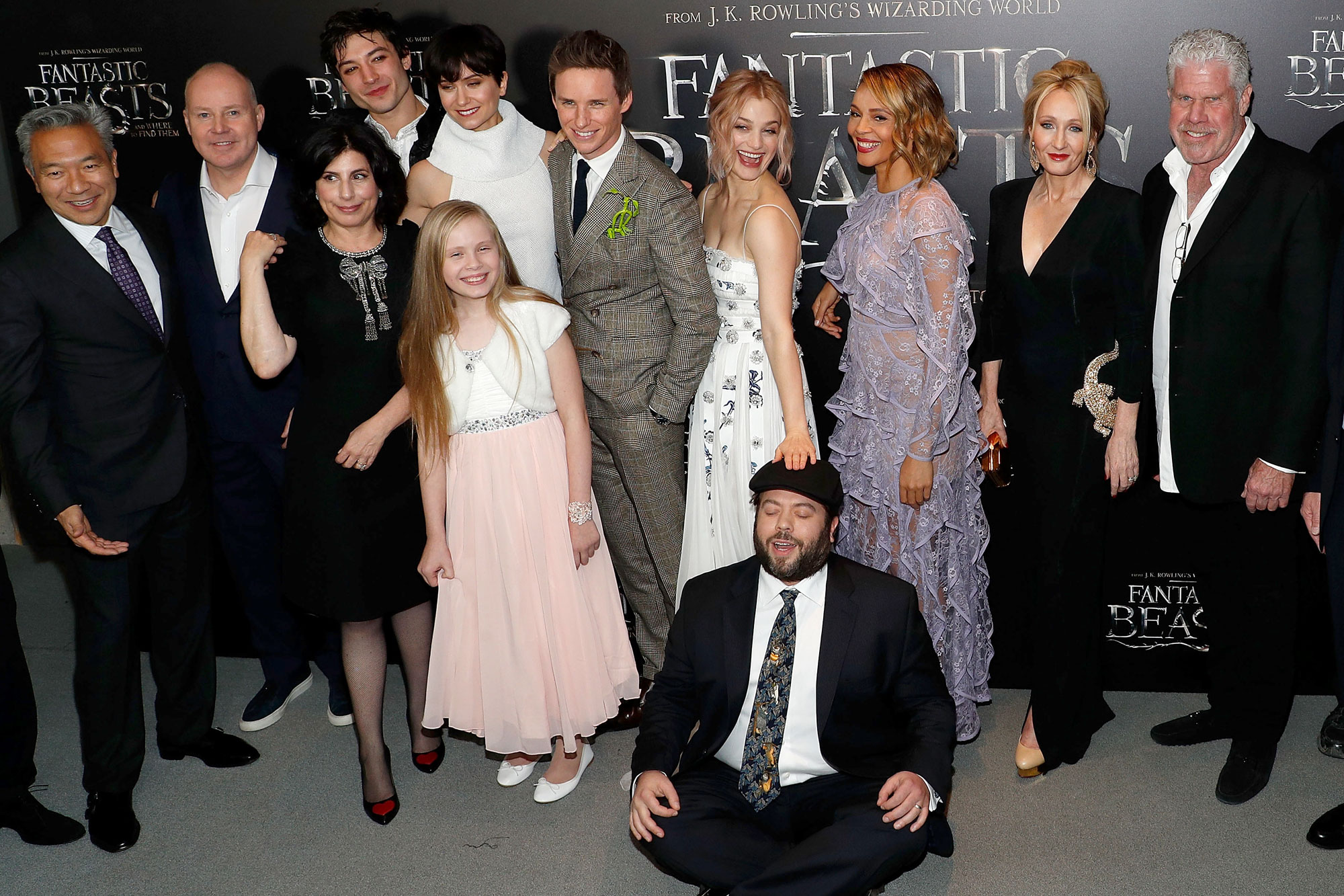 "NEW YORK, NY - NOVEMBER 10: (L-R) Kevin Tsujihara, David Yates, Sue Kroll, Ezra Miller, Katherine Waterston, Faith Wood-Blagrove, Eddie Redmayne, Alison Sudol, Dan Fogler, Carmen Ejogo, J. K. Rowling and Ron Pearlman attend the premiere of ""Fantastic Beasts and Where to Find Them"" at Alice Tully Hall, Lincoln Center on November 10, 2016 in New York City. (Photo by Taylor Hill/FilmMagic)"
