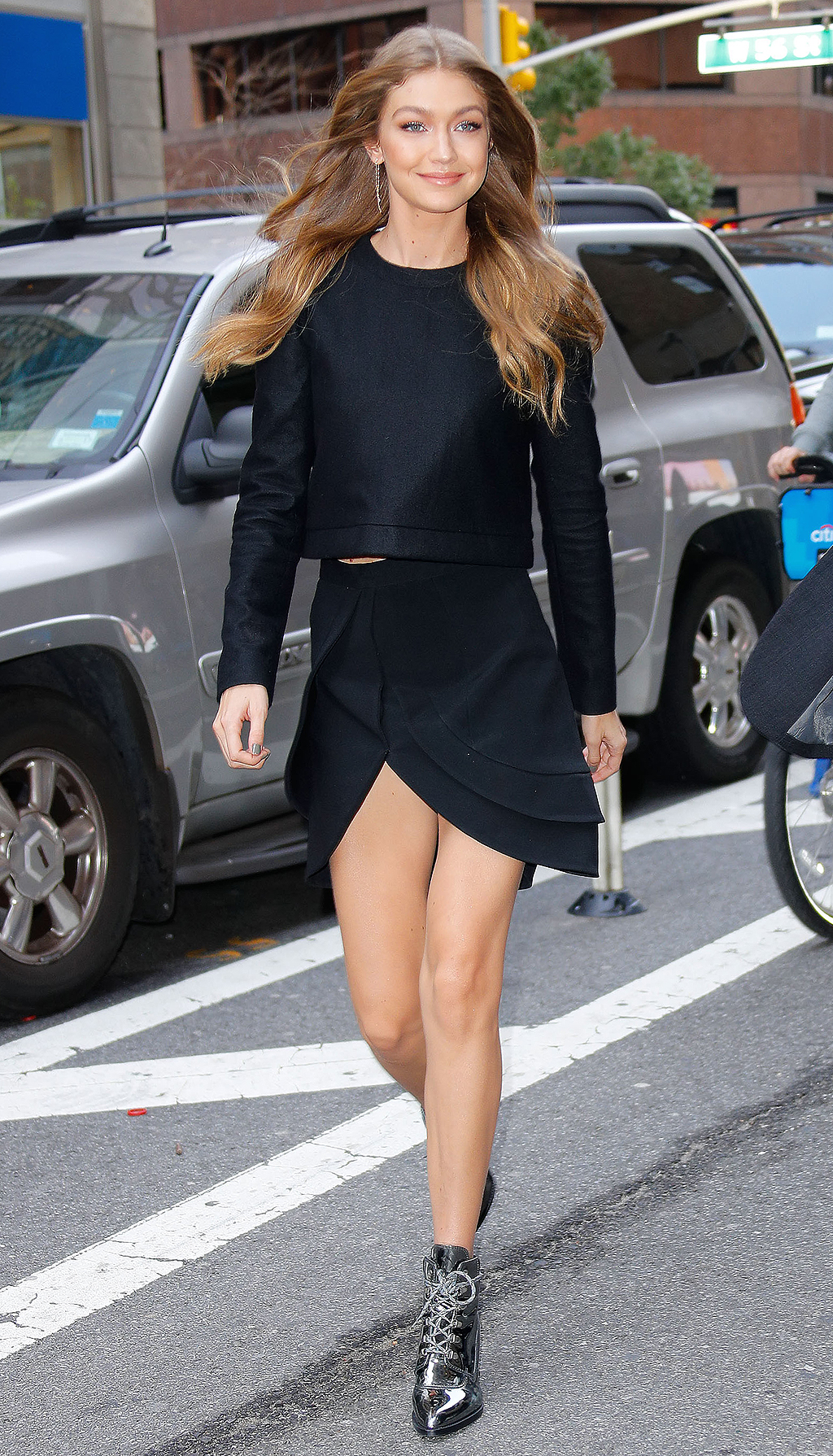 Gigi Hadid is all smiles when out and about in a chic black outfit in New York