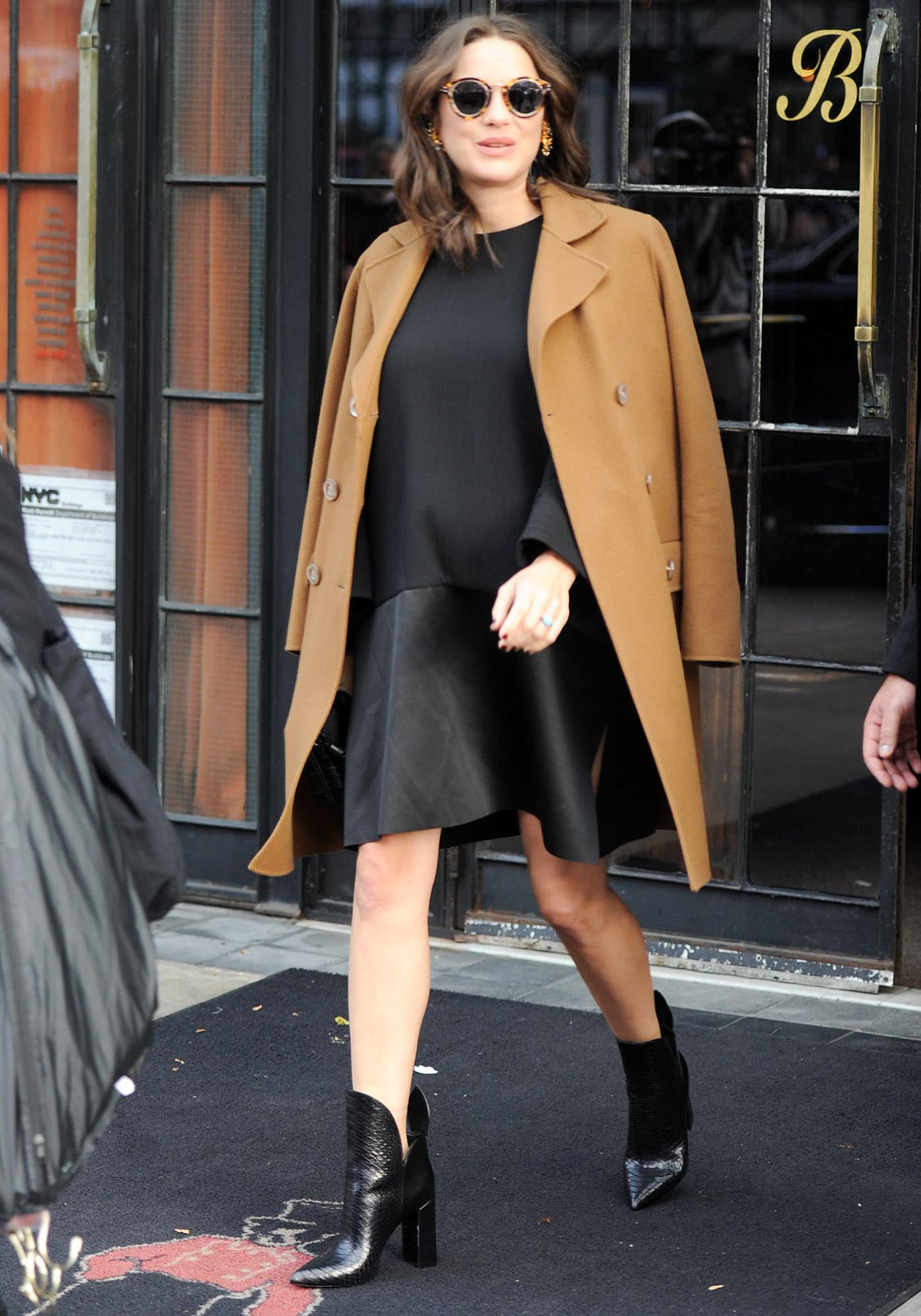 Pregnant Marion Cotillard leaves her hotel in New York City