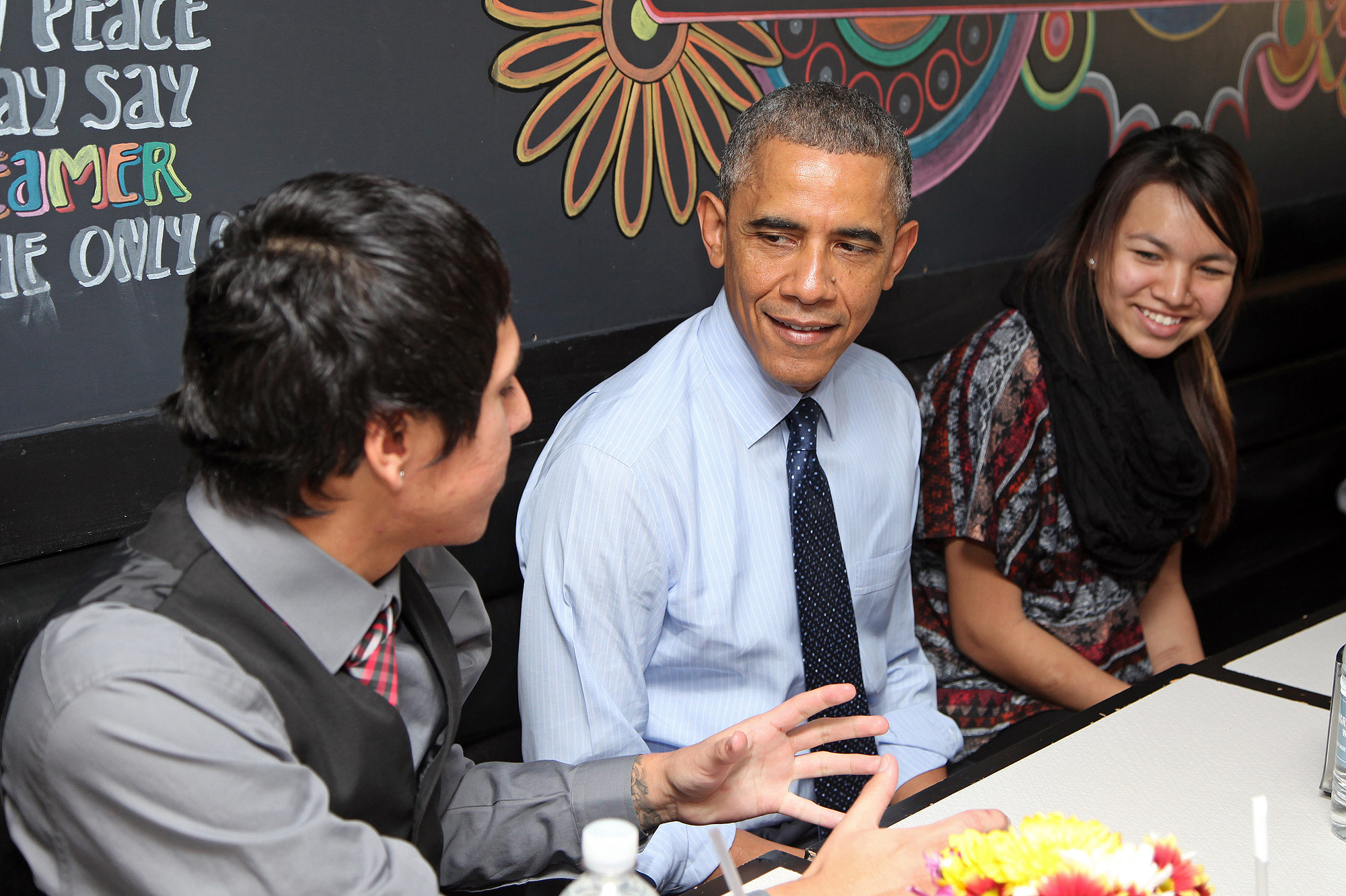 WASHINGTON, DC - NOVEMBER 20: U.S. President Barack Obama has lunch with Standing Rock Sioux Tribal Youth at We, The Pizza/Good Stuff Eatery following an Oval Office greeting on November 20, 2014 in Washington, DC. President Obama invited the youth group to visit the White House during a trip to the Standing Rock Sioux Reservation in Cannonball, North Dakota in June.